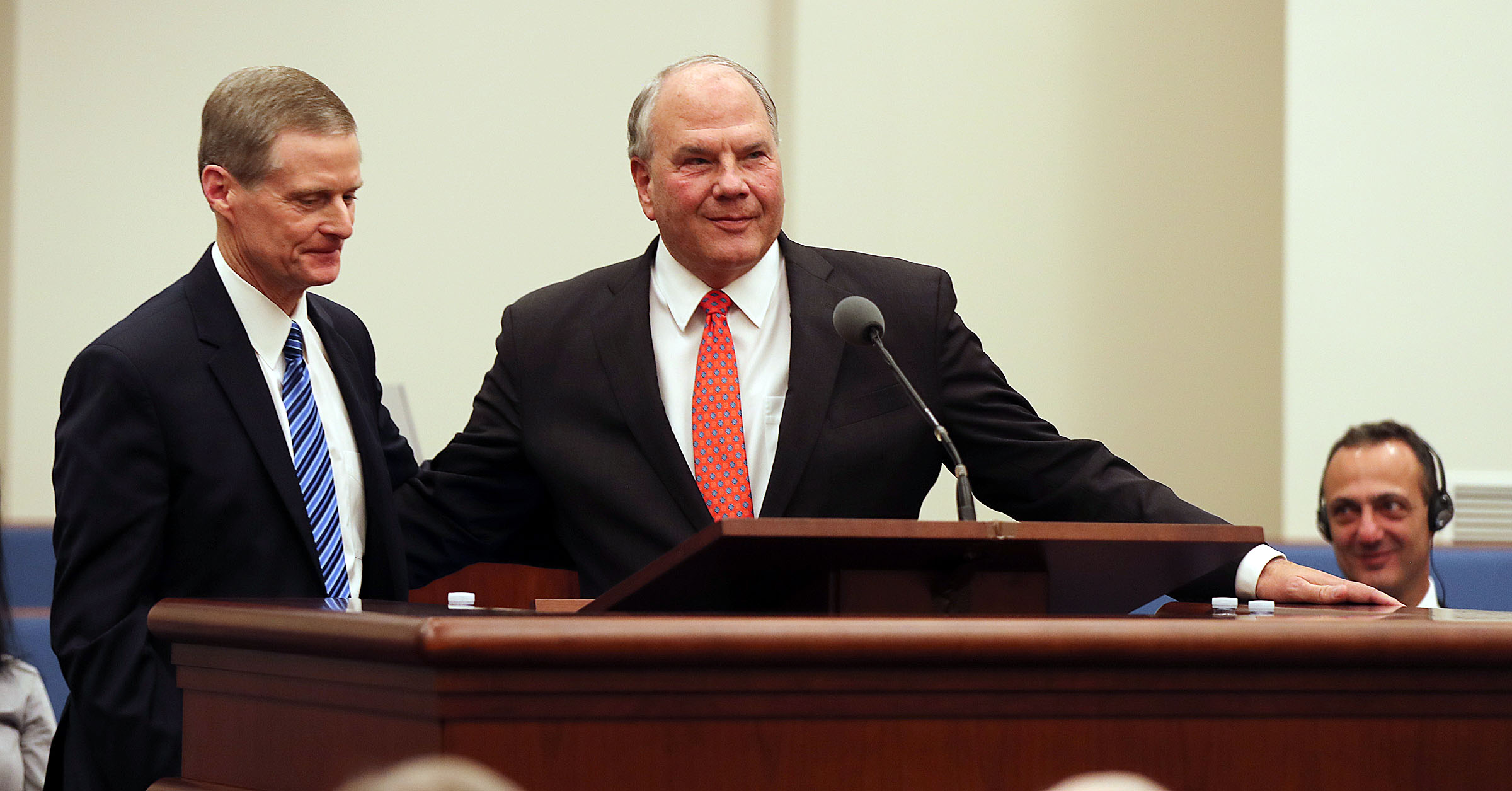Elder Ronald A. Rasband, right, of the Quorum of the Twelve Apostles of The Church of Jesus Christ of Latter-day Saints speaks after an invitation by Elder David A. Bednar during a press briefing at a meetinghouse on the Rome Italy Temple grounds on Monday, Jan. 14, 2019. At back right is President Marcello De Vito, president of the Rome City Council.