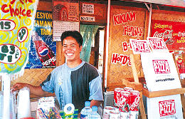 Jesse Manguerra began a business selling pizza two roadside kiosks and 16 schools.
