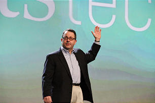 Shipley Munson, marketing manager for FamilySearch International gives greeting at keynote session for RootsTech 2014 conference on Feb. 6.