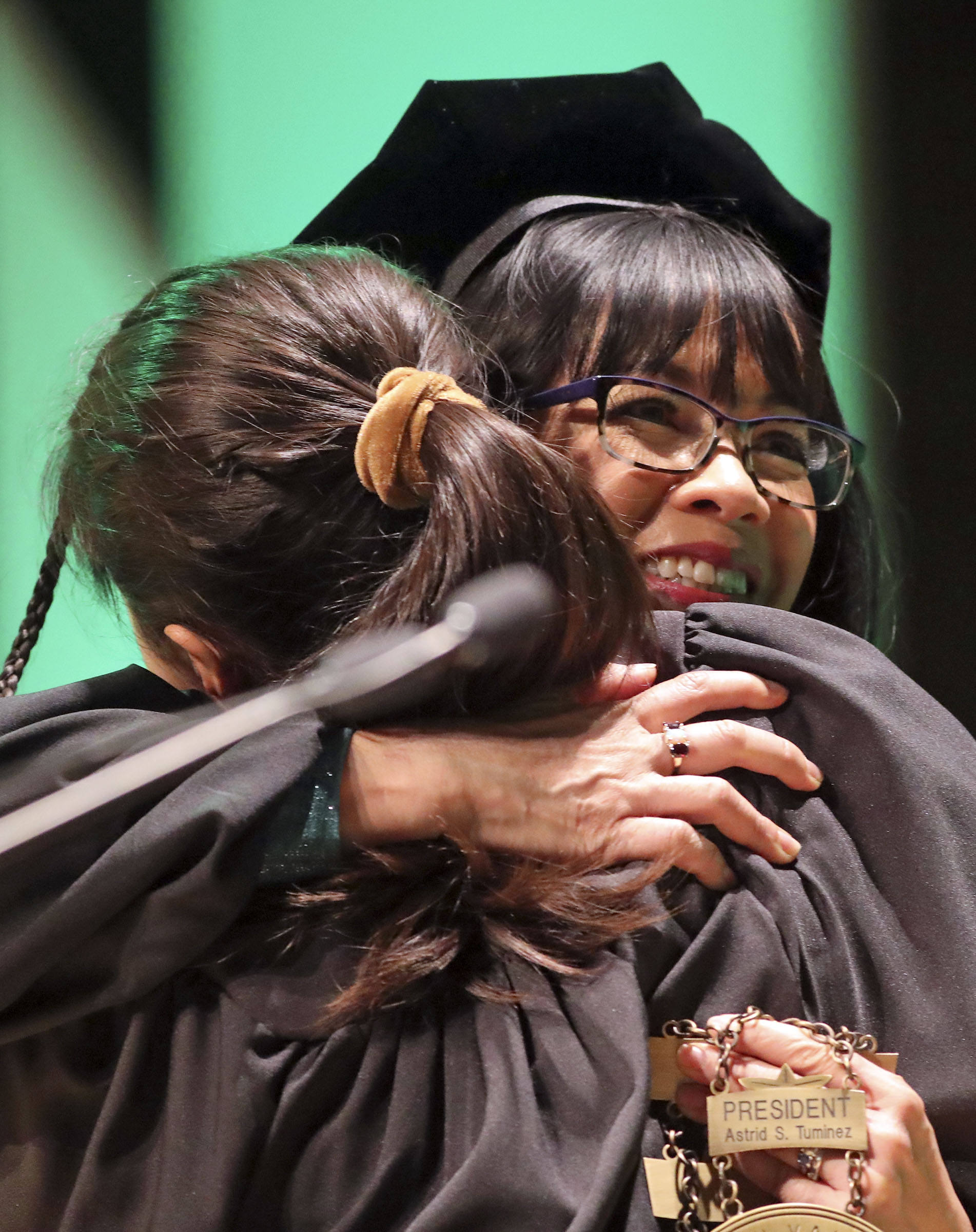 Michal Tuminez Tolk hugs her mother, Astrid S. Tuminez, Utah Valley University's seventh president, during the inauguration ceremony for Tuminez at the UVU Noorda Center for the Performing Arts in Orem on Wednesday, March 27, 2019.