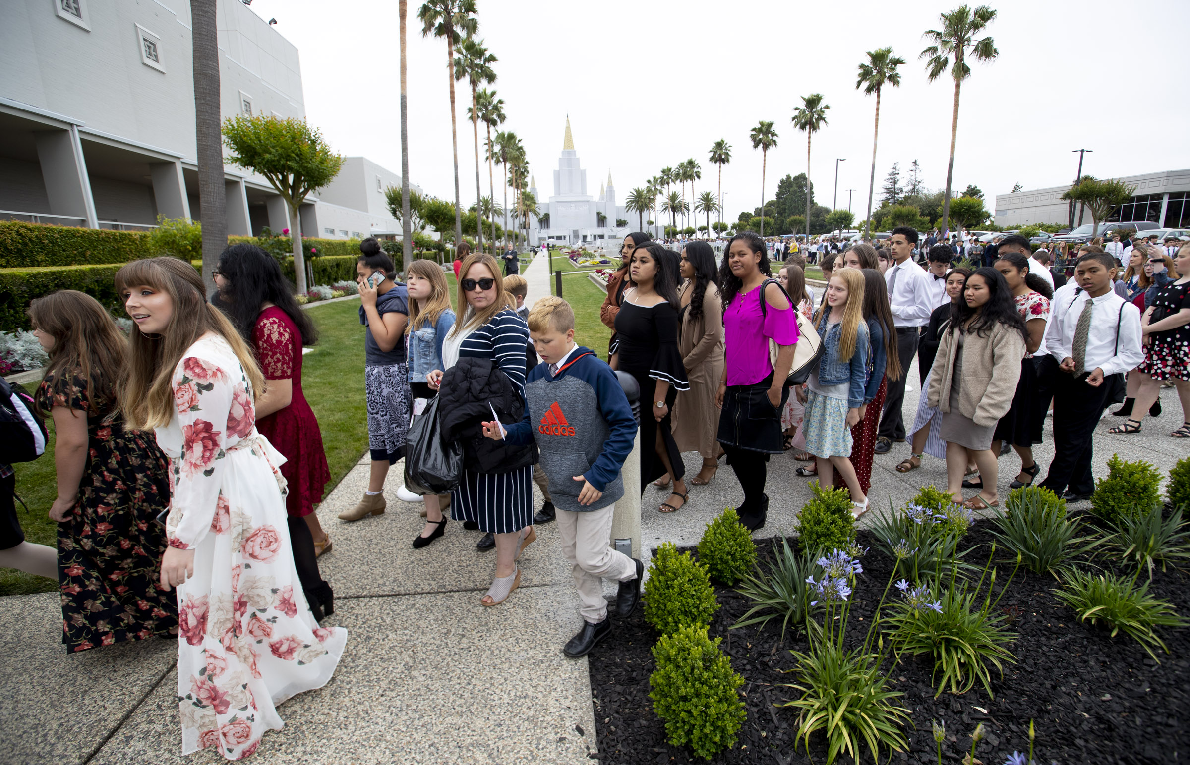 Youth wait in line to attend a devotional at the Interstake Center on the Oakland California Temple grounds on Saturday, June 15, 2019.