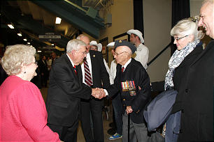 Elder M. Russell Ballard greets Lester Card, one of Canada's military veterans who were honored during a cultural program held Saturday evening, Oct. 27, in celebration of the dedication of the Calgary Alberta Temple.