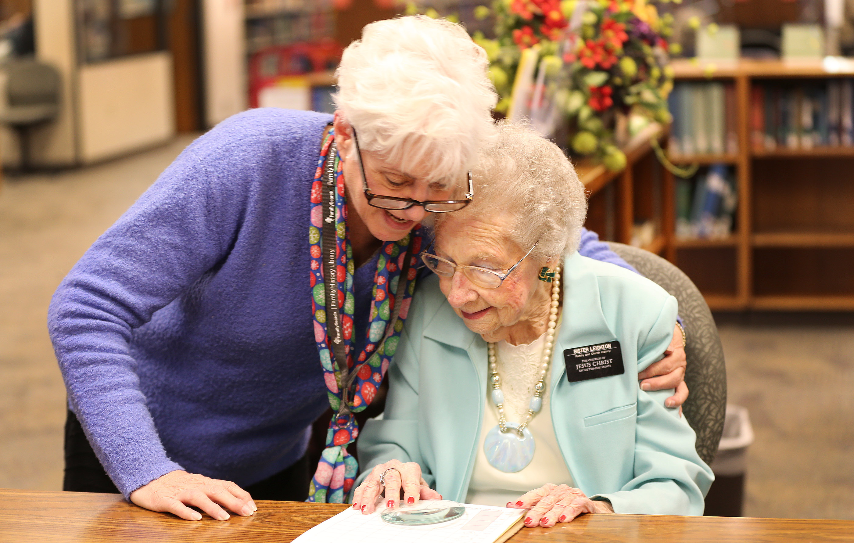 Nellie Leighton, 99, right, is hugged by fellow missionary Raelene Tondro at the Family History Library in Salt Lake City on Tuesday, Jan. 22, 2019. Leighton will celebrate her 100th birthday in February.