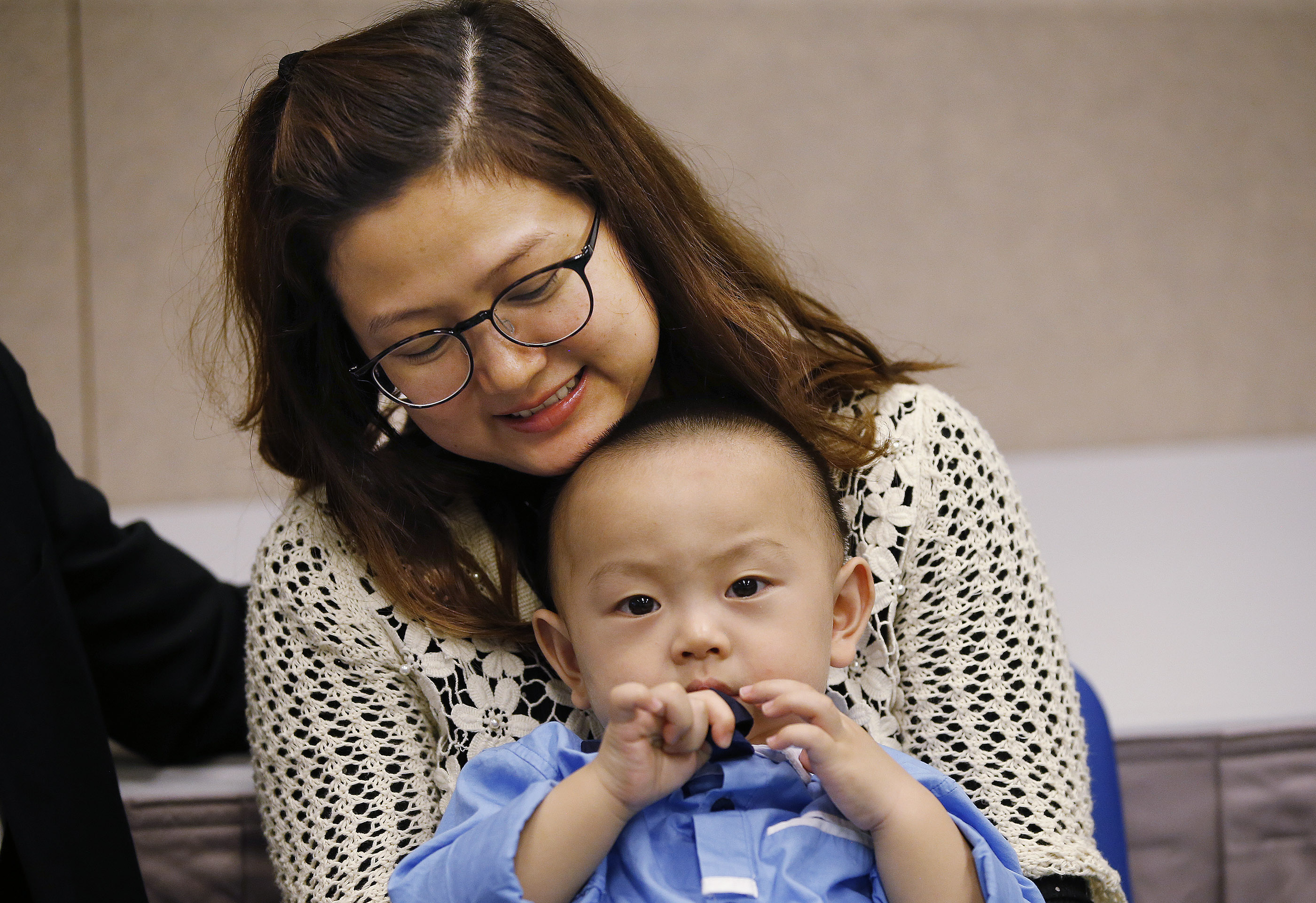Sunny Hong holds her son Hyrum prior to meeting with President Russell M. Nelson and Elder Jeffrey R. Holland of the Quorum of the Twelve Apostles for a devotional in Hong Kong on Saturday, April 21, 2018.