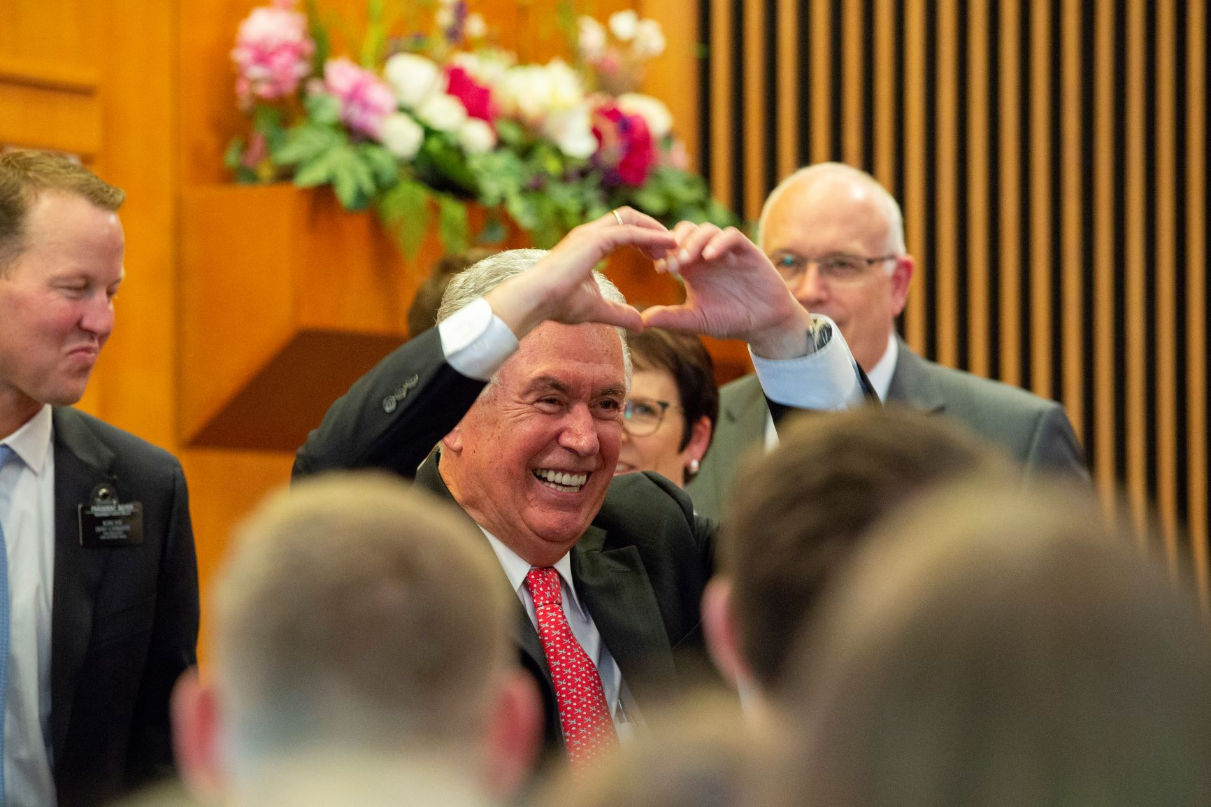 Following a Sept. 11, 2018, conference with the Germany Frankfurt Mission, Elder Dieter F. Uchtdorf of the Quorum of the Twelve Apostles gestures his love for the missionaries.