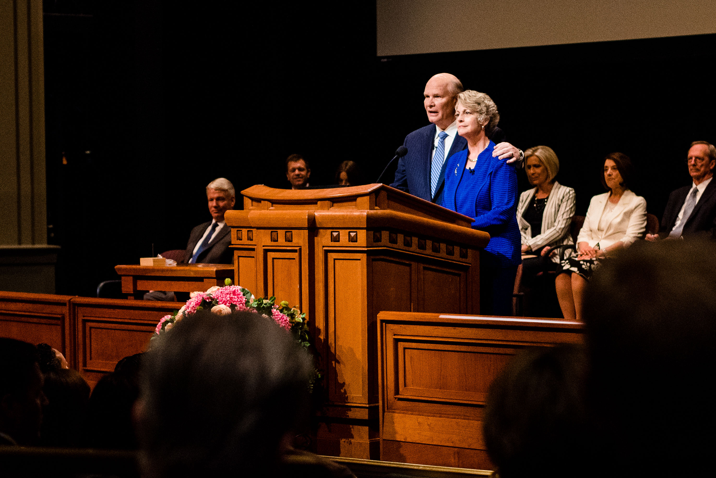 Elder Dale G. Renlund of the Quorum of the Twelve Apostles and his wife, Sister Ruth L. Renlund, speak during a broadcast for seminary and institute instructors held in the Conference Center Theater in Salt Lake City on June 12.