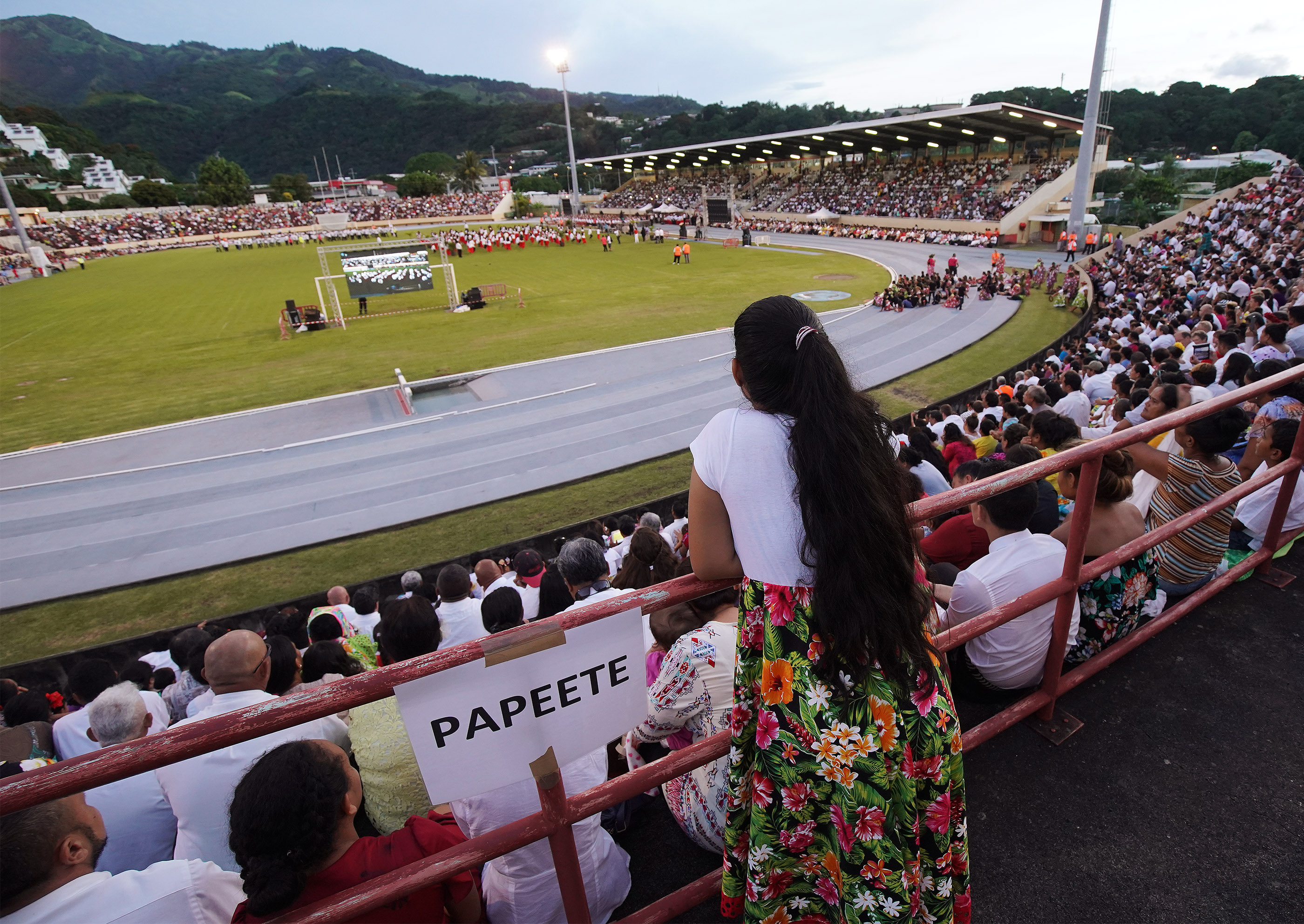 Attendees watch performers during a Tahiti cultural program in Papeete, Tahiti, on May 24, 2019.