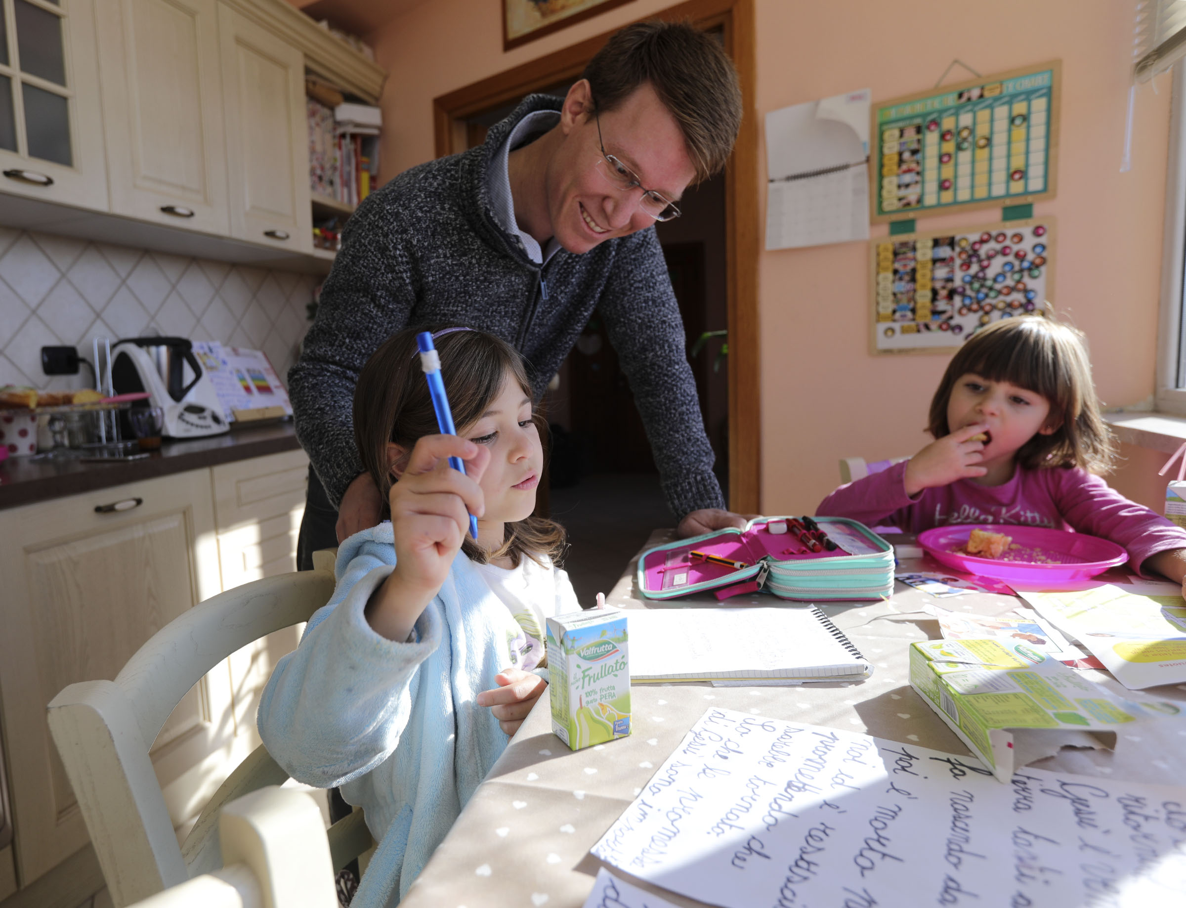 Emma Salerno, 7, prepares her Primary talk as her father, Daniele, and sister, Alice, 3, watch at home in Rome, Italy, on Sunday morning, Nov. 18, 2018.