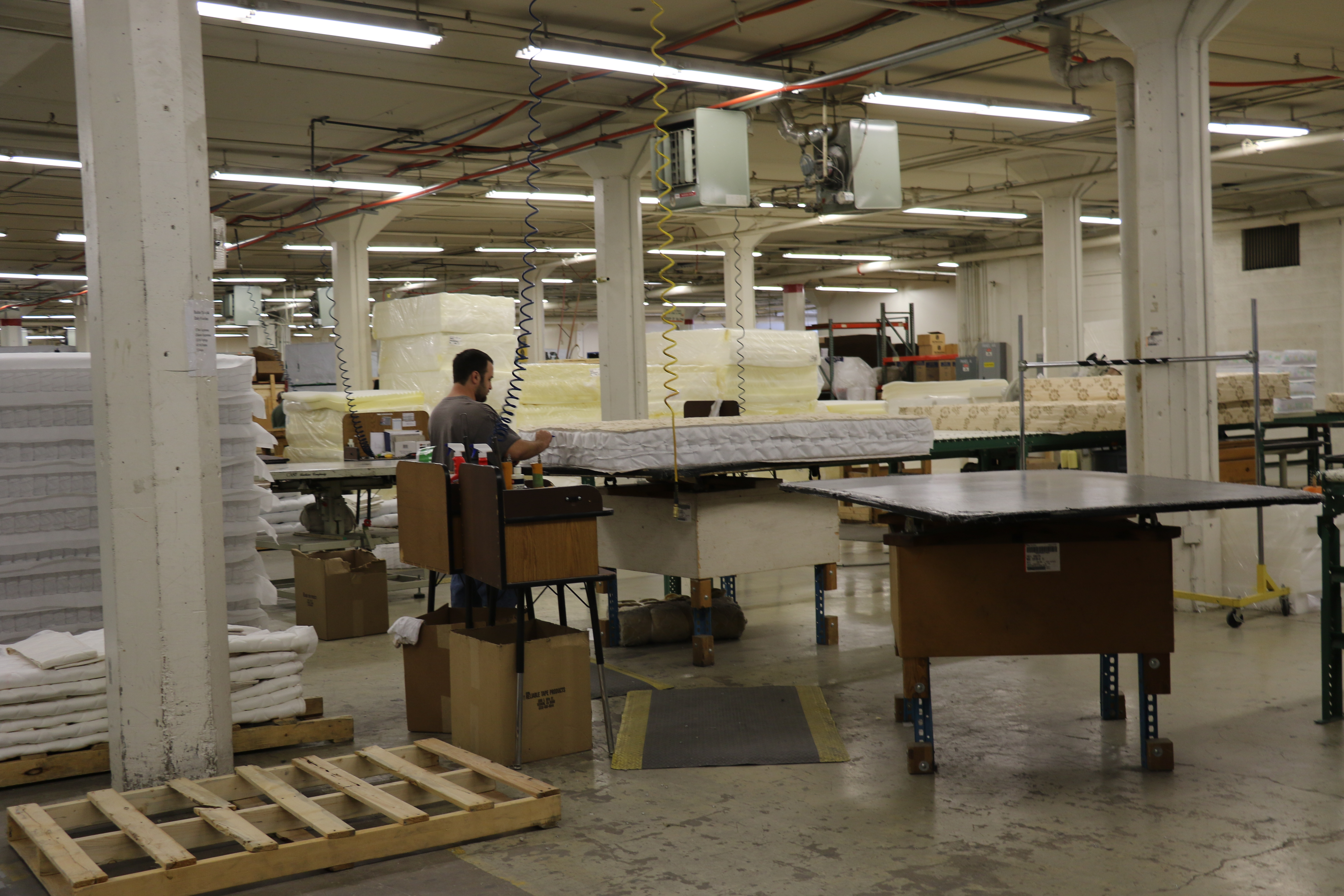 Workers put together mattresses in the Deseret Manufacturing facility in Salt Lake City, Utah.