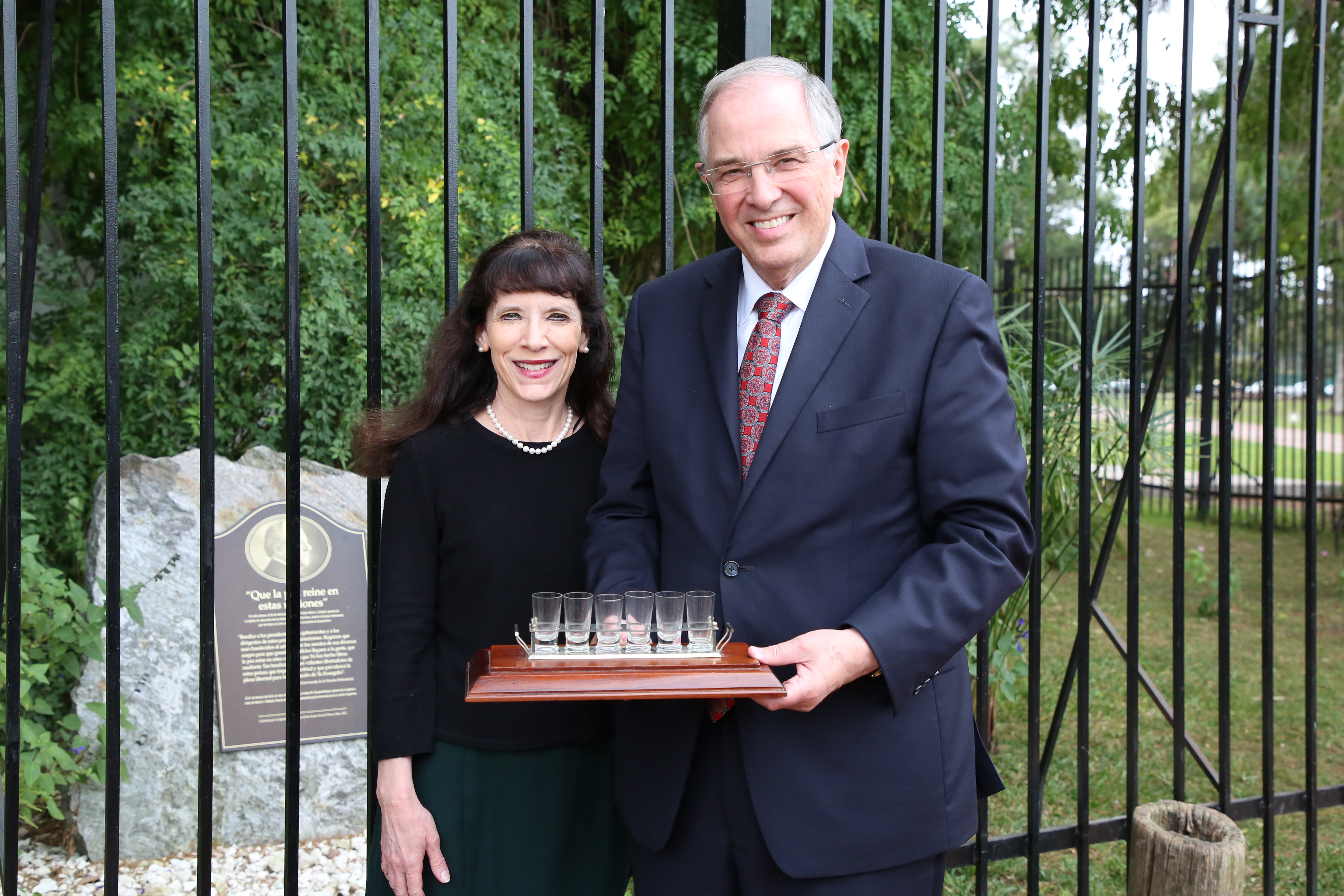 Elder Neil L. Andersen of the Quorum of the Twelve Apostles and Sister Kathy Andersen in Buenos Aires, Argentina, visit the spot where Elder Melvin J. Ballard blessed the land of South America in 1925. In Elder Andersen's hands is a book of history, including the decision in 1925 to open the South American Mission.