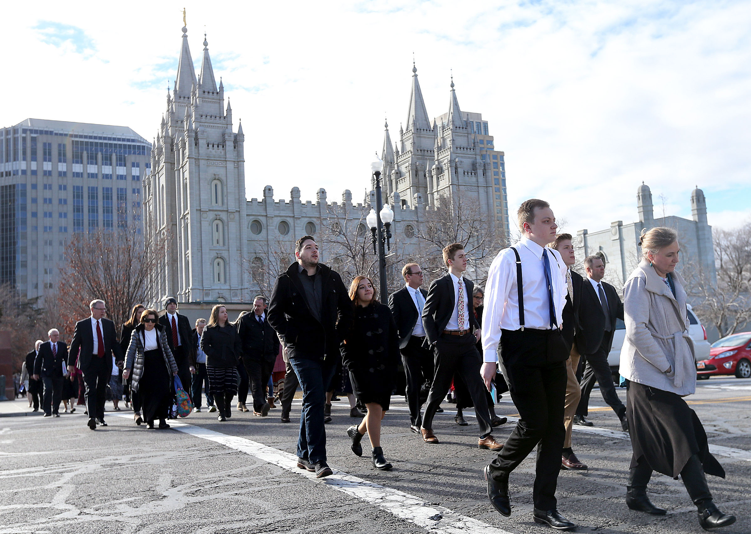 People walk toward the Conference Center in Salt Lake City for LDS Church President Thomas S. Monson's funeral on Friday, Jan. 12, 2018.