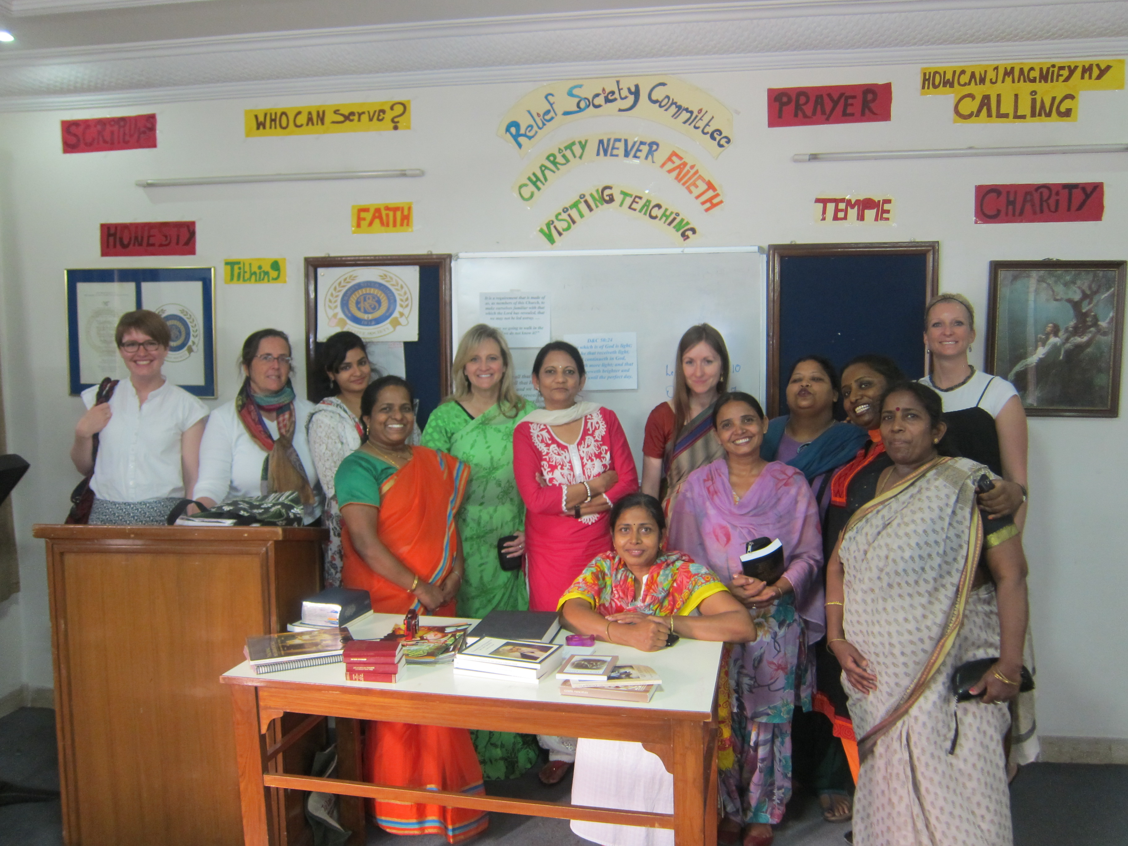 Taunalyn Rutherford, in green, stands with Relief Society sisters during academic research in New Delhi, India, in 2014.