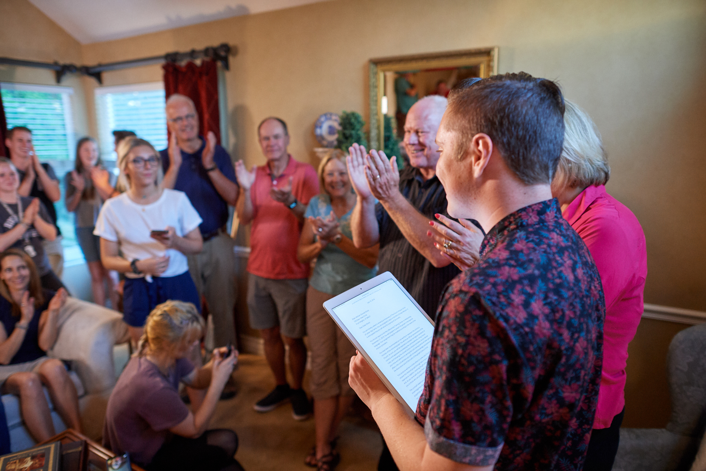 Excited family and friends react after 17-year-old Billy Elliott opens his online mission assignment to the Peru Chiclayo Mission. The Church is rolling out a new initiative where missionary candidates receive their call online rather than in the mail.