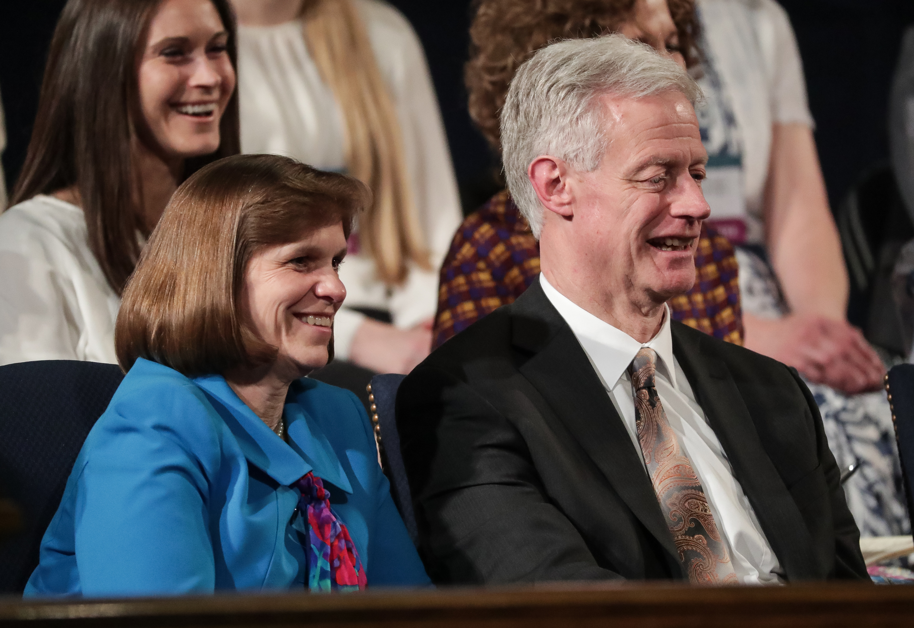 BYU President Kevin J Worthen and his wife, Peggy, listen as Elder Gerrit W. Gong, of the Quorum of the Twelve Apostles of the LDS Church, and his wife, Sister Susan Gong, speak at the BYU Women's Conference at the Marriott Center in Provo on Friday, May 4, 2018.
