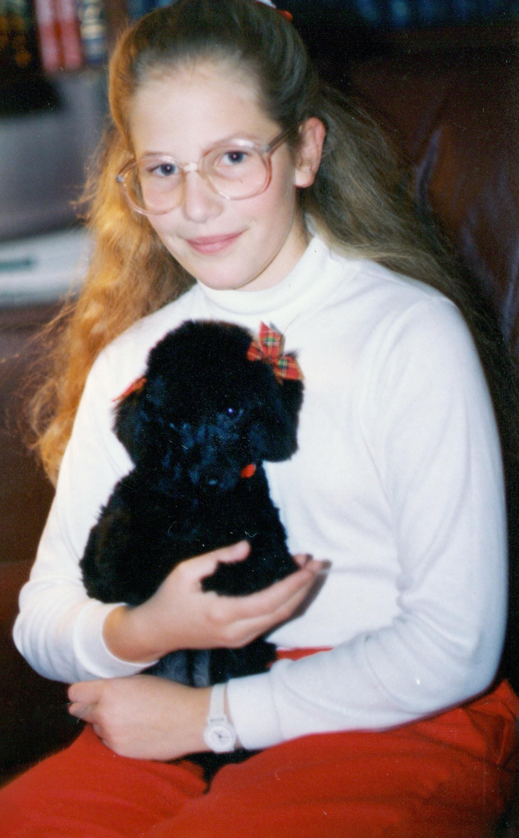 Ashley Renlund holds Lady, the family dog.