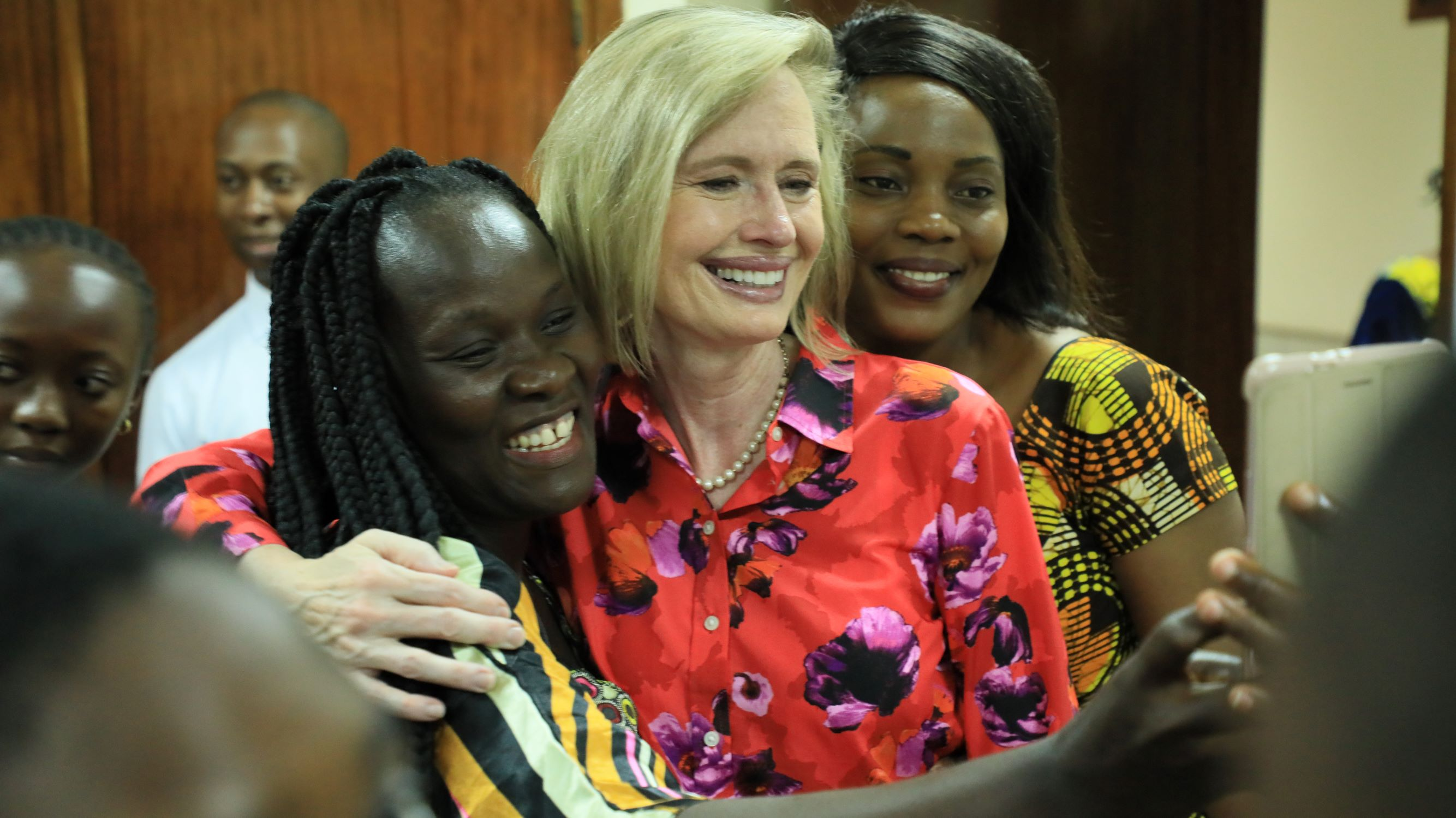 Young women take a picture with Sister Bonnie H. Cordon, Young Women general president, in Abidjan, Côte d'Ivoire, Friday, March 8, 2019.