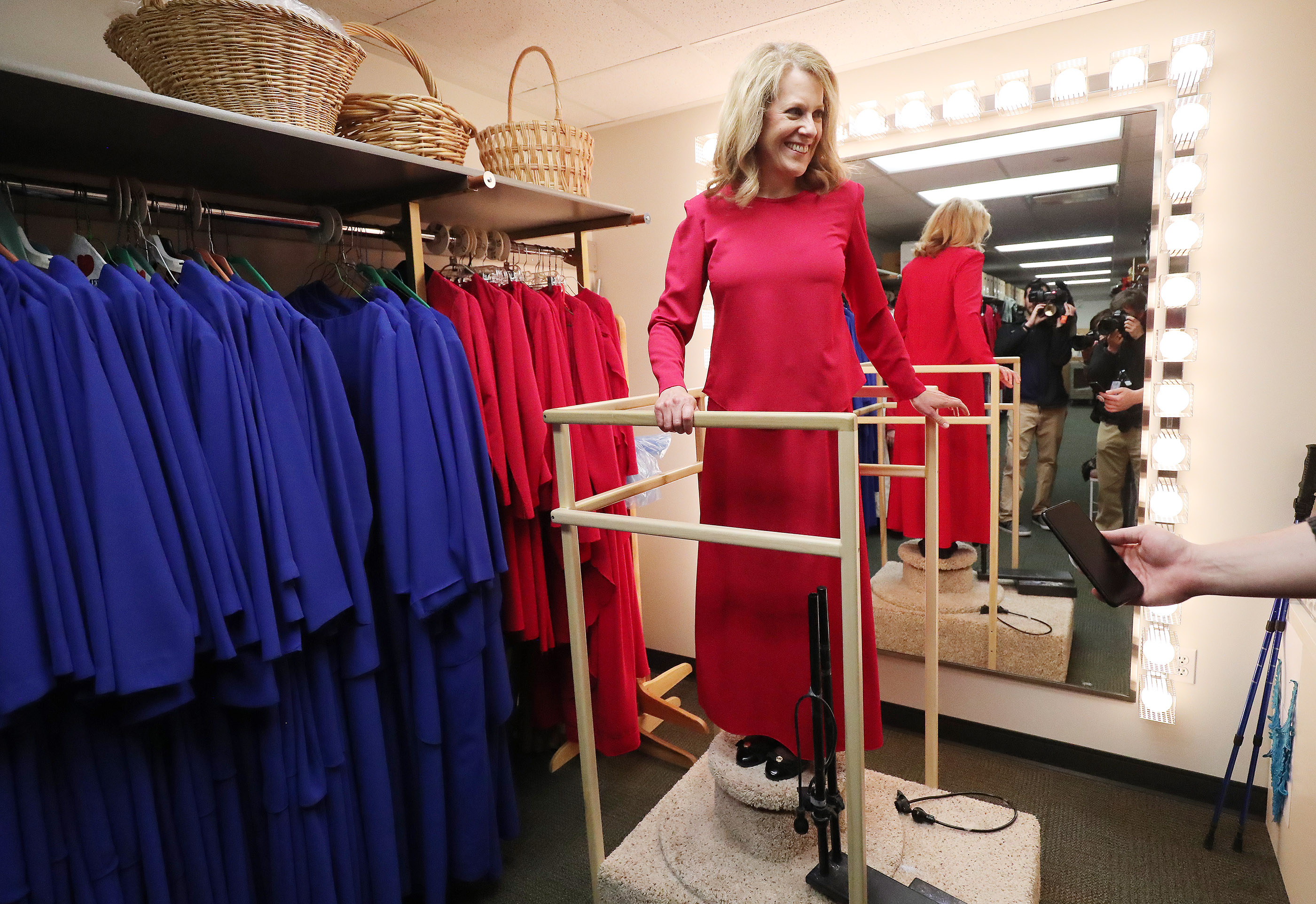 Debbie Matheson tries on a dress in preparation to sing with The Tabernacle Choir at Temple Square during a rehearsal in Salt Lake City on Thursday, April 11, 2019. Four people were selected through social media to sing with the choir.