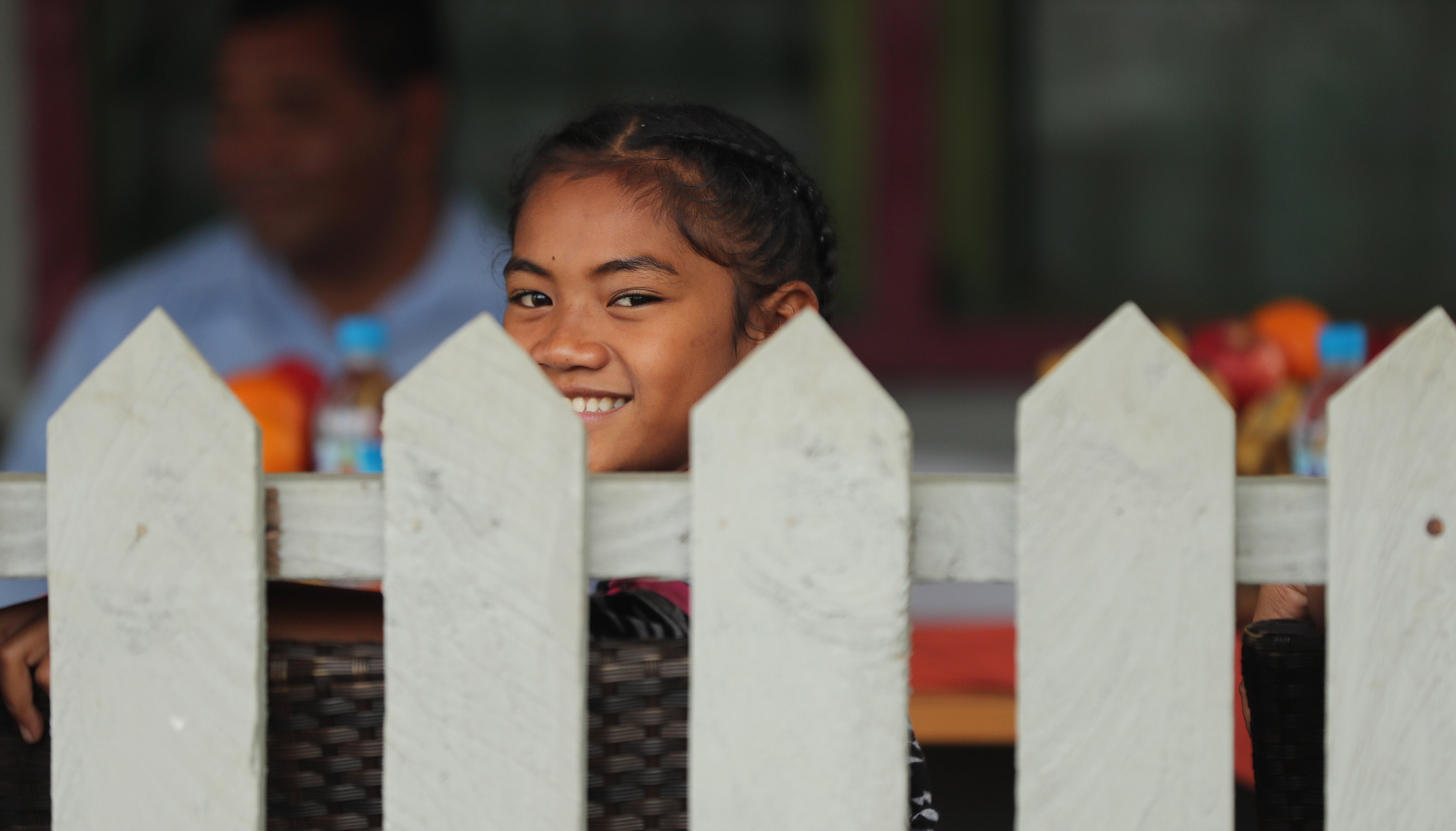 Falakika Latu sits on the porch at home in Tonga on May 23, 2019. Her father Tohiminiti Latu is bishop of his ward and has 10 children and one grandchild.