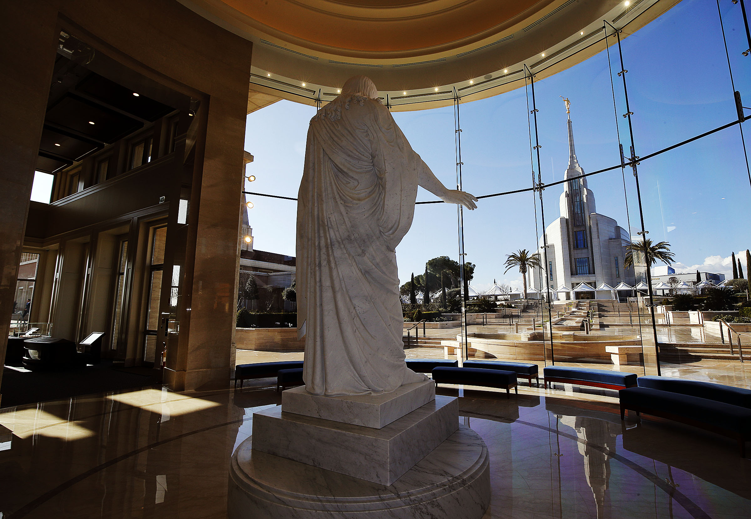 The Rome Italy Temple is seen through the window of the Rome Temple Visitor's Center of The Church of Jesus Christ of Latter-day Saints on Monday, Jan. 14, 2019. In the foreground is a statue of Christ.