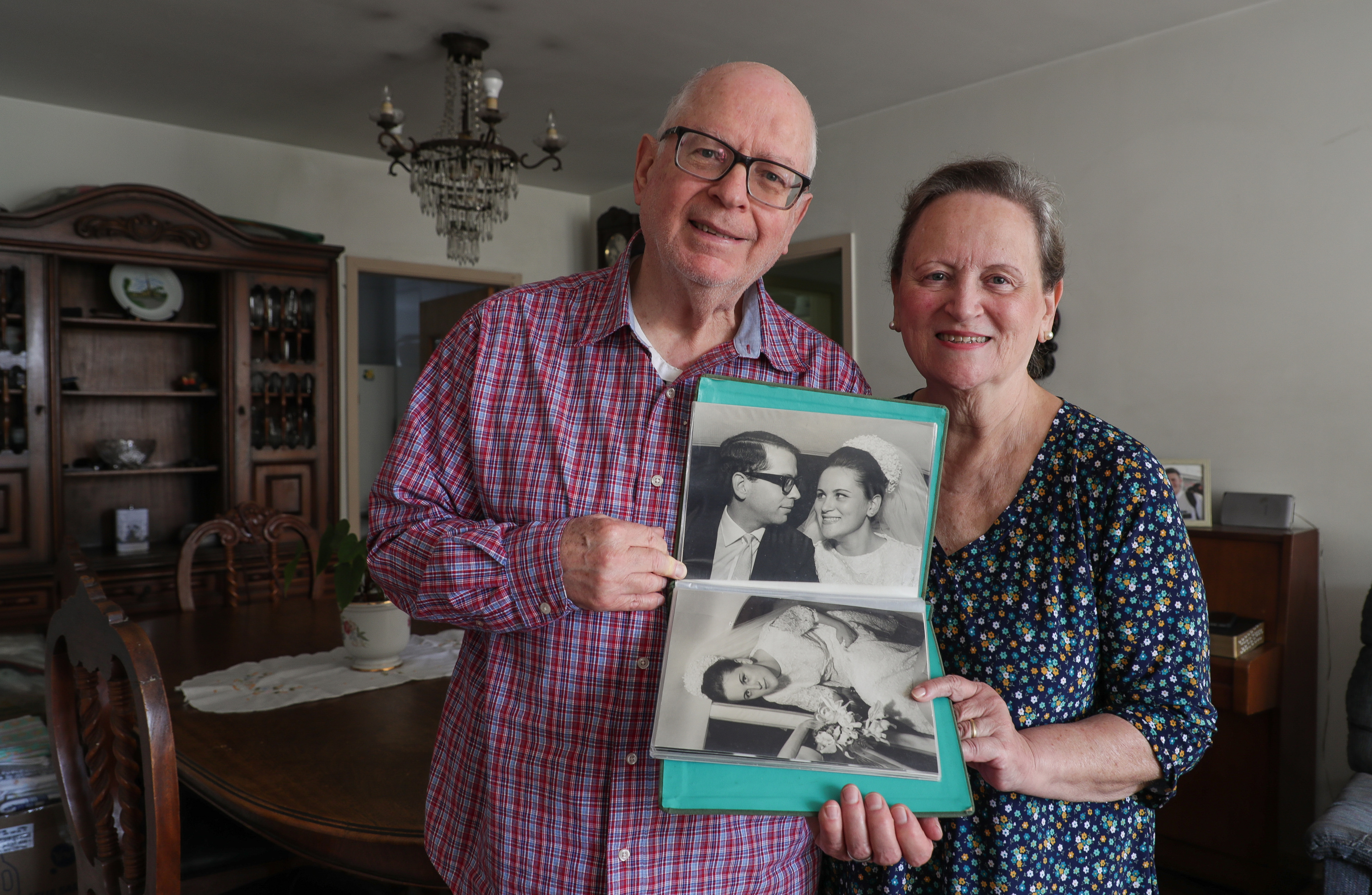 Demar and Sandra Staniscia pose for a photo with photos from their wedding night at their apartment in São Paulo, Brazil on Wednesday, May 23, 2018.