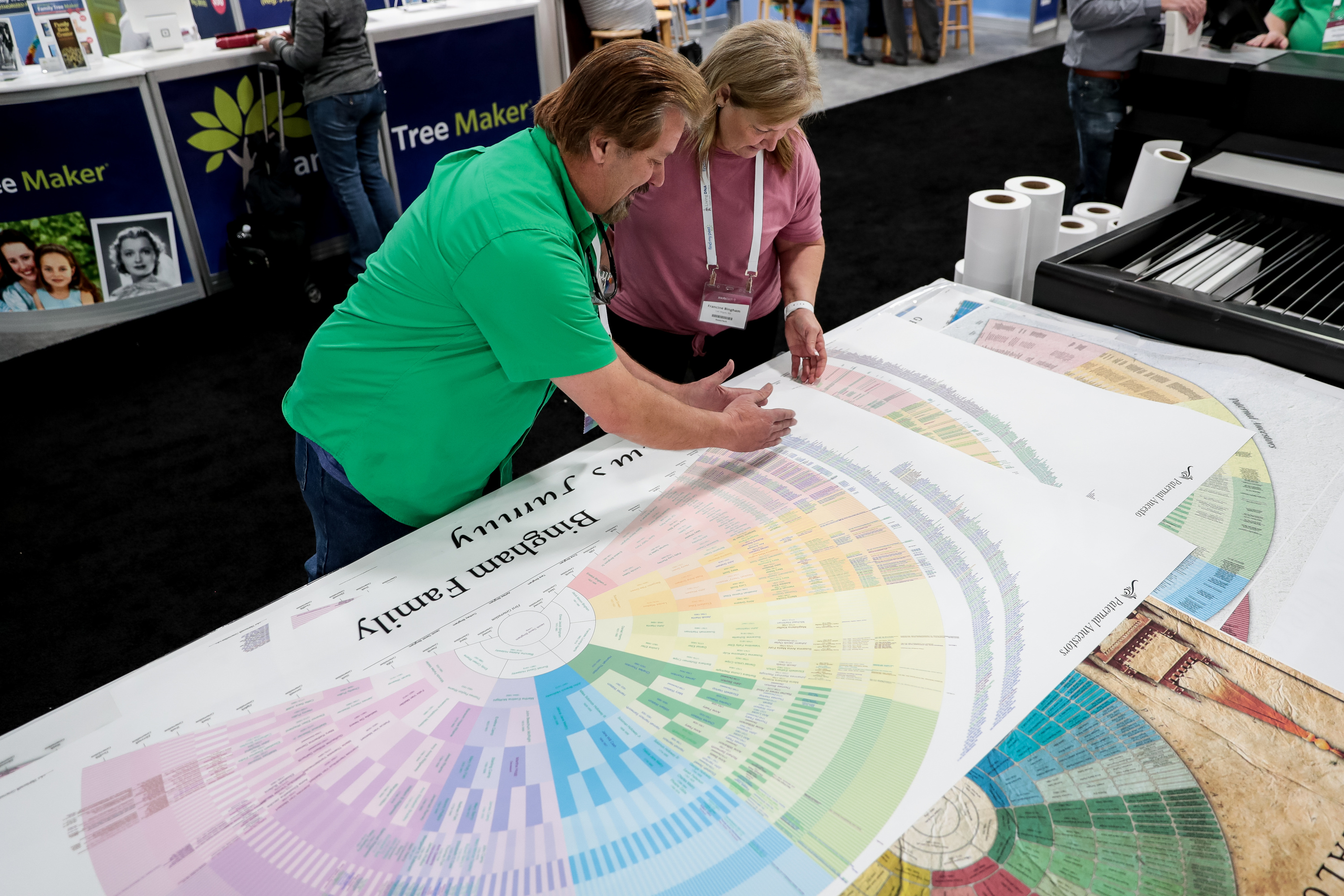 Kevin Cook, of Genealogy Wall Charts, talks to Francine Bingham about her chart at the RootsTech conference at the Salt Palace in Salt Lake City on Friday, March 1, 2019.