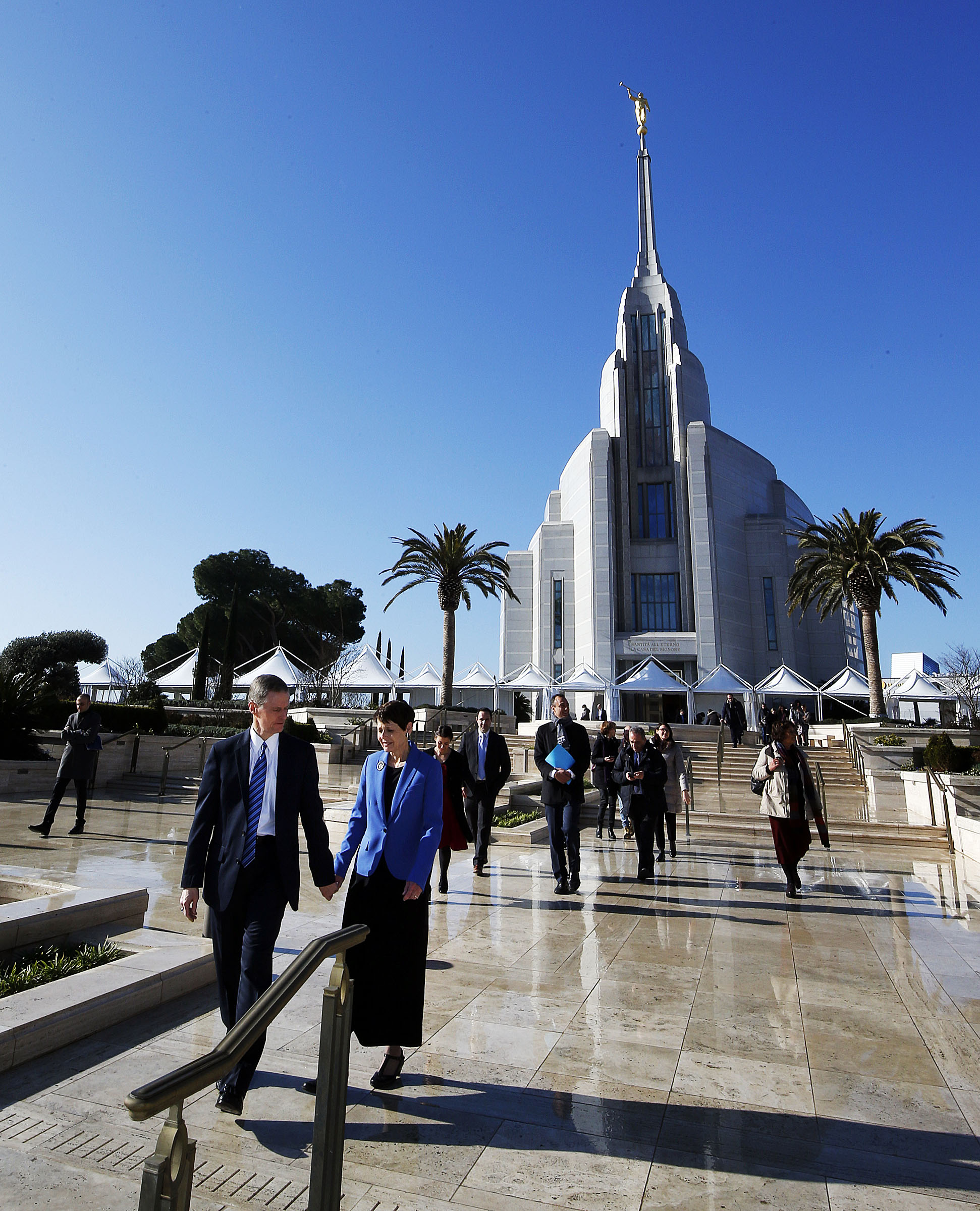 Elder David A. Bednar of the Quorum of the Twelve Apostles and his wife, Sister Susan Bednar, walk from the Rome Italy Temple to the Rome Temple Visitors' Center of The Church of Jesus Christ of Latter-day Saints on Monday, Jan. 14, 2019. Rome City officials and other dignitaries follow behind.