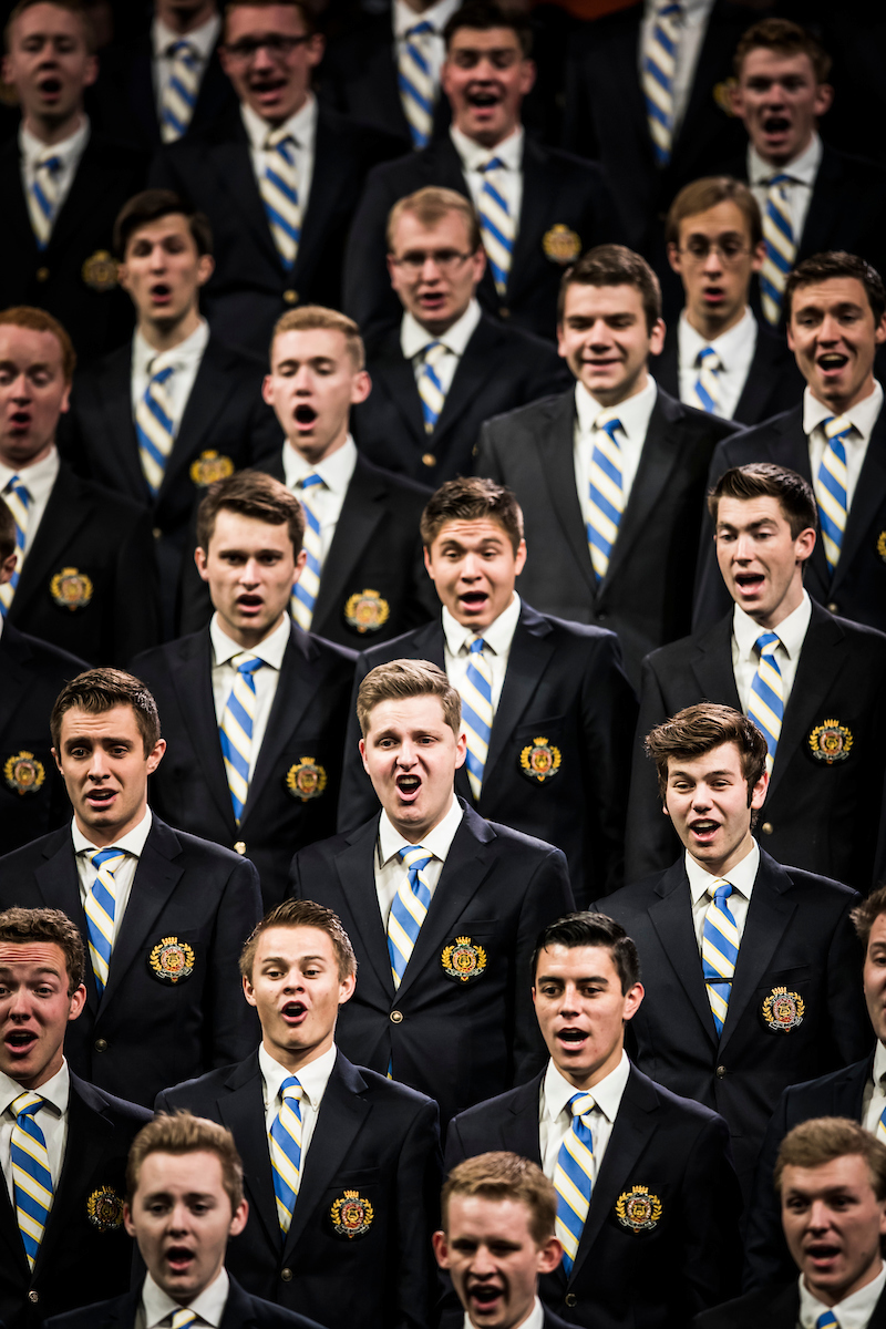 A men's choir of BYU students perform during a campus devotional on April 10.
