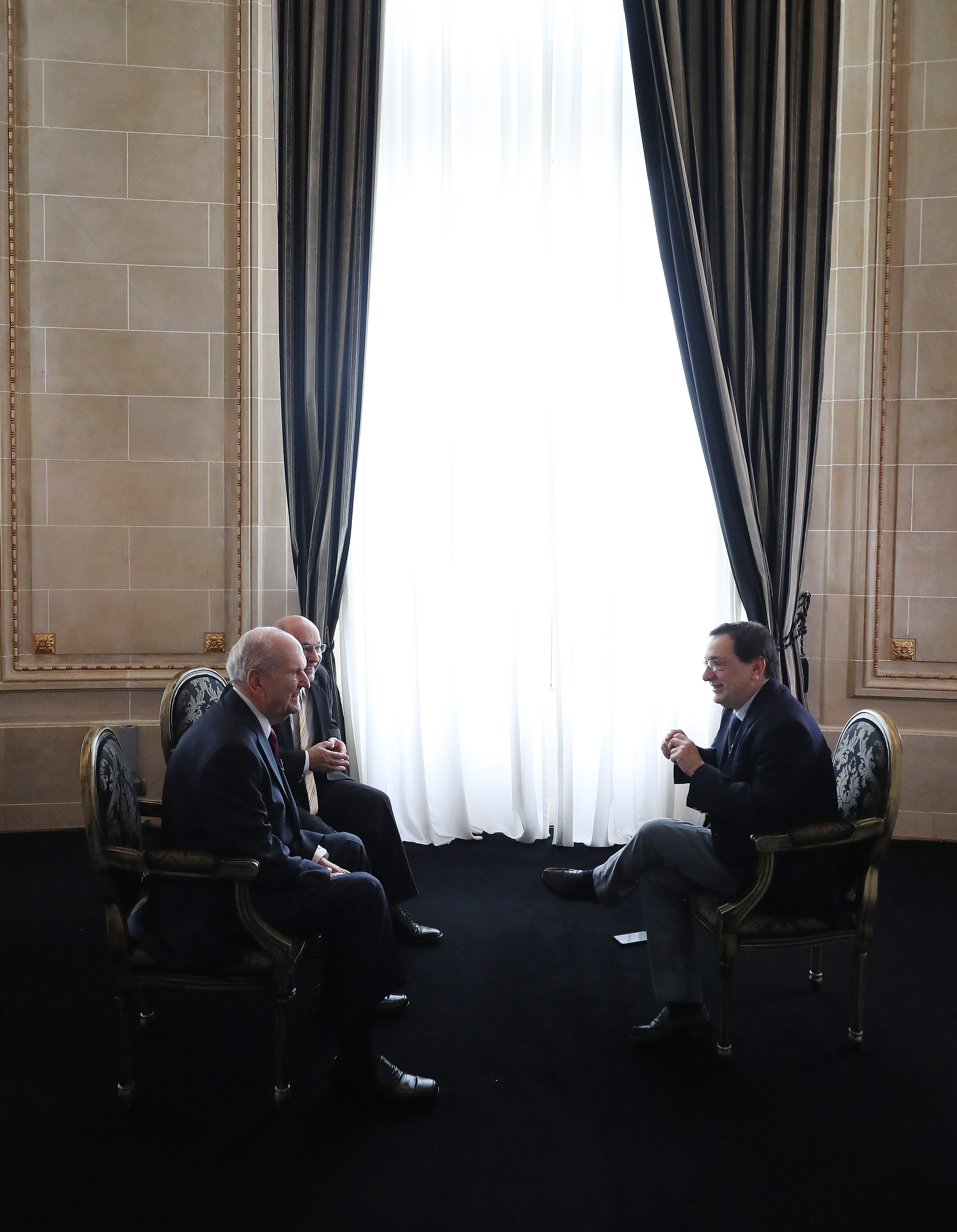 President Russell M. Nelson of The Church of Jesus Christ of Latter-day Saints, left, is interviewed by Sergio Rubin, Argentine journalist and biographer of Pope Francis, in Montevideo, Uruguay on Oct. 26, 2018. Carlos Aguero, right, interprets.
