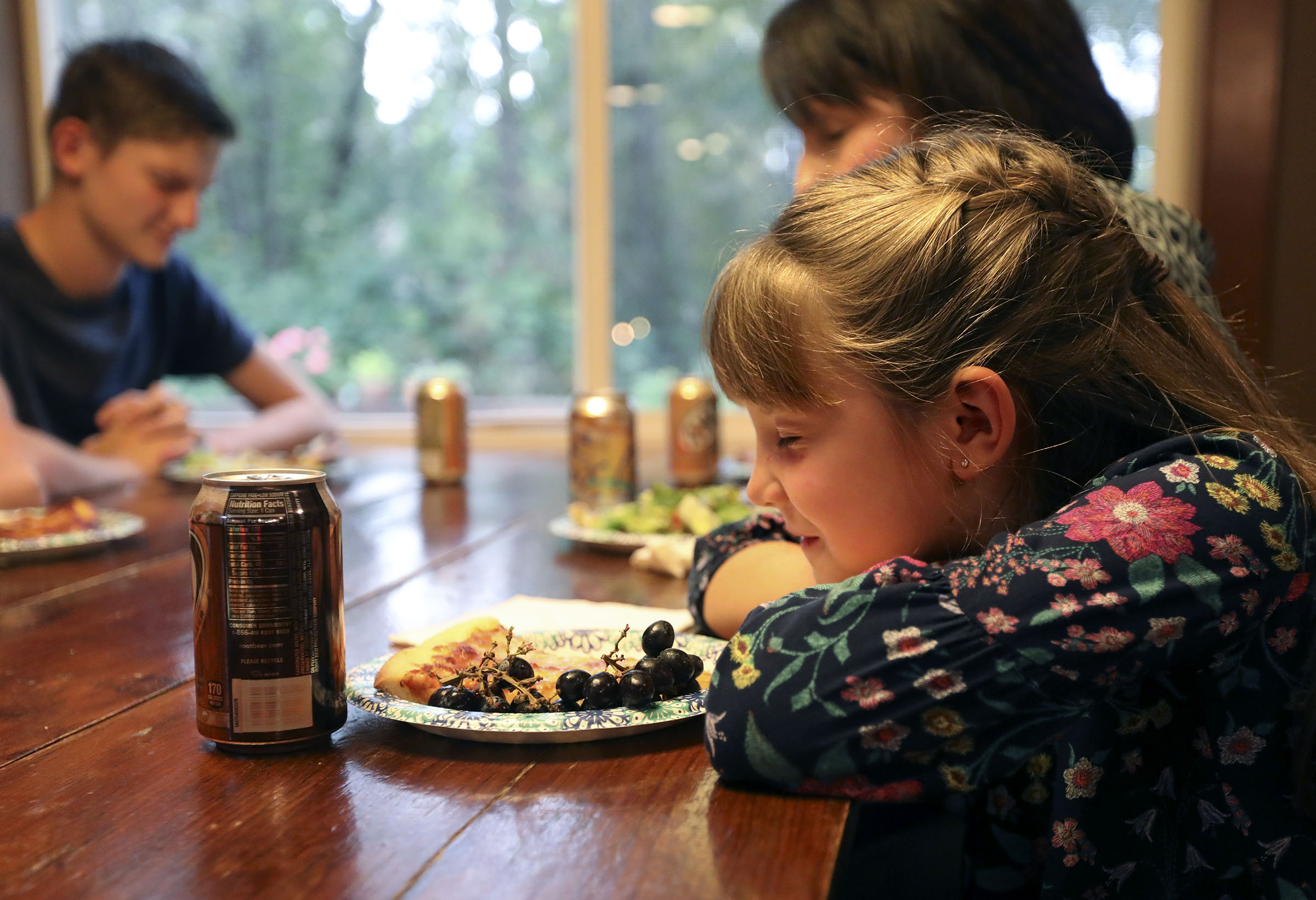 Emilia Allen prays before dinner at home in Renton, Wash., on Friday, Sept. 14, 2018.