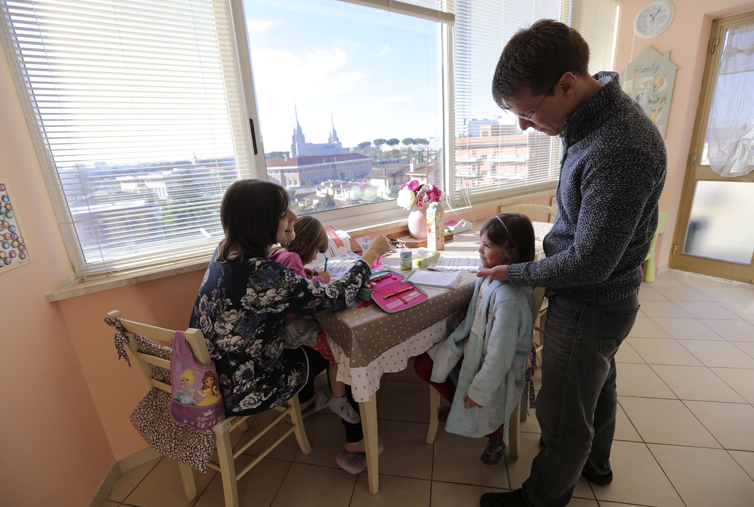 Norma, Alice, Emma and Daniele Salerno chat at the kitchen table, overlooking the Rome Temple, at home in Rome, Italy, on Sunday morning, Nov. 18, 2018.