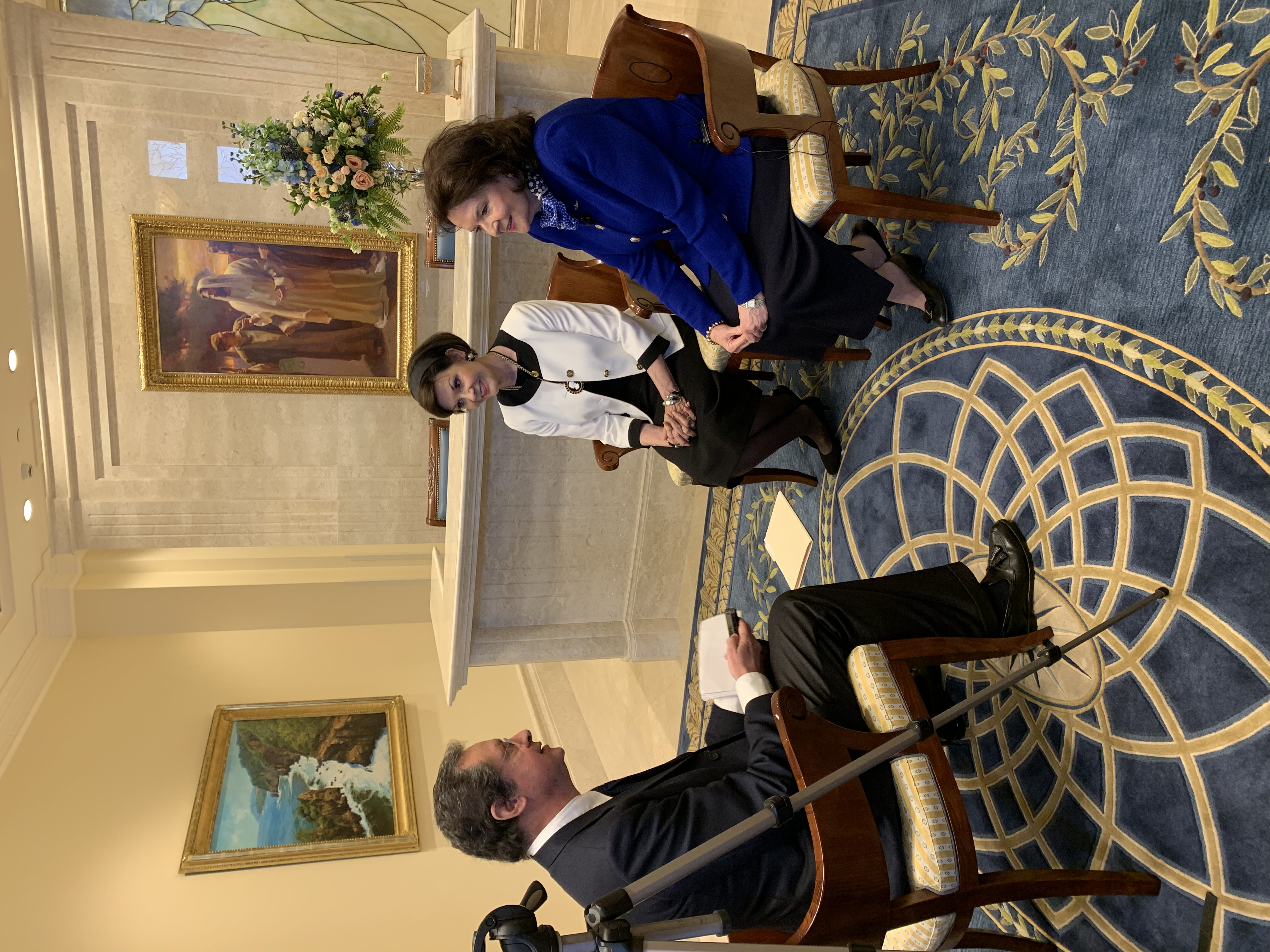 Sister Wendy Nelson, right, and Sister Kristen Oaks interview with Paolo Mastrolilli, the New York correspondent for the national Italian newspaper La Stampa, in the lobby of the Rome Italy Temple on March 11.