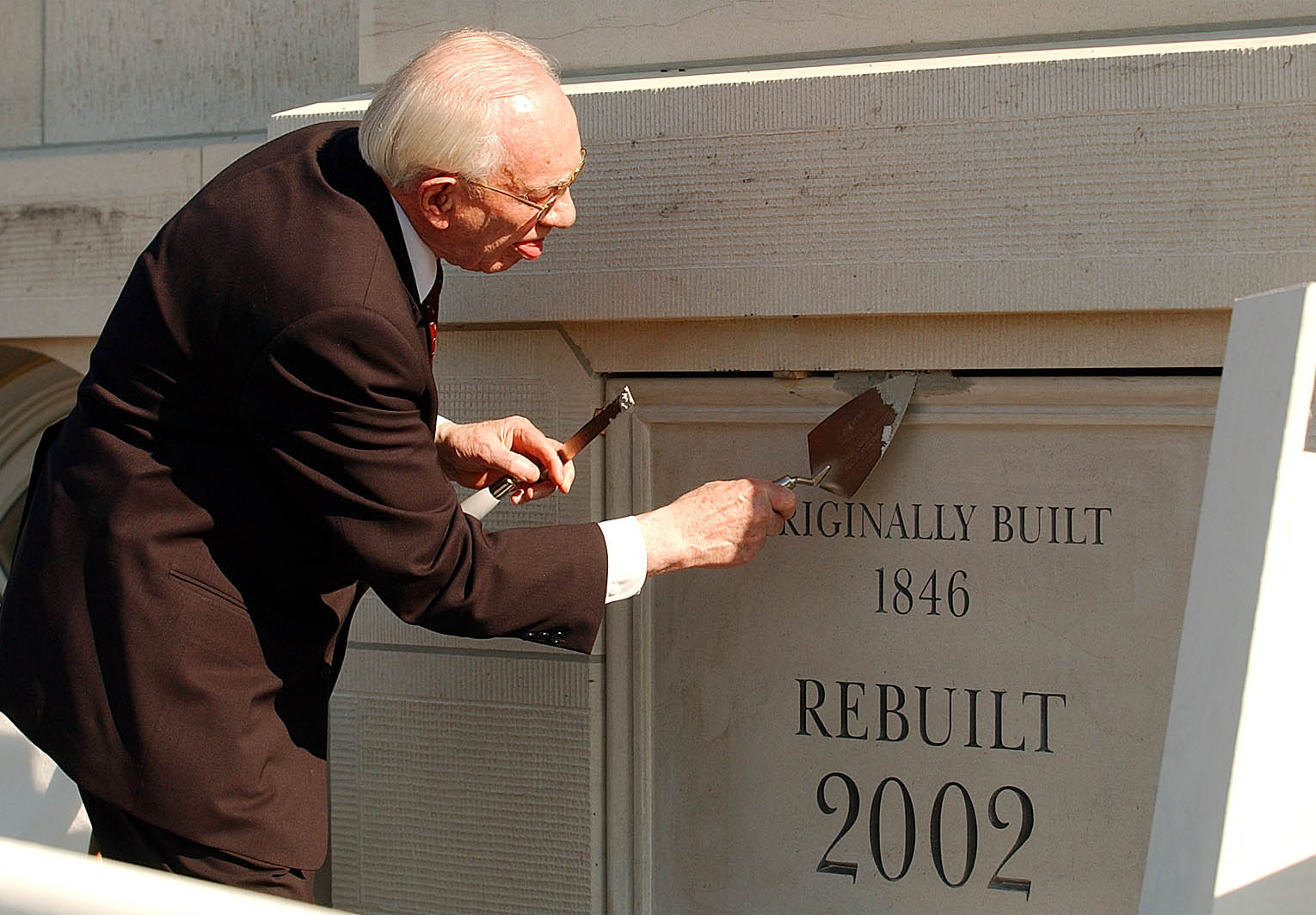 President Gordon B. Hinckley applies mortar to the cornerstone at the Nauvoo Illinois Temple on June 27, 2002.
