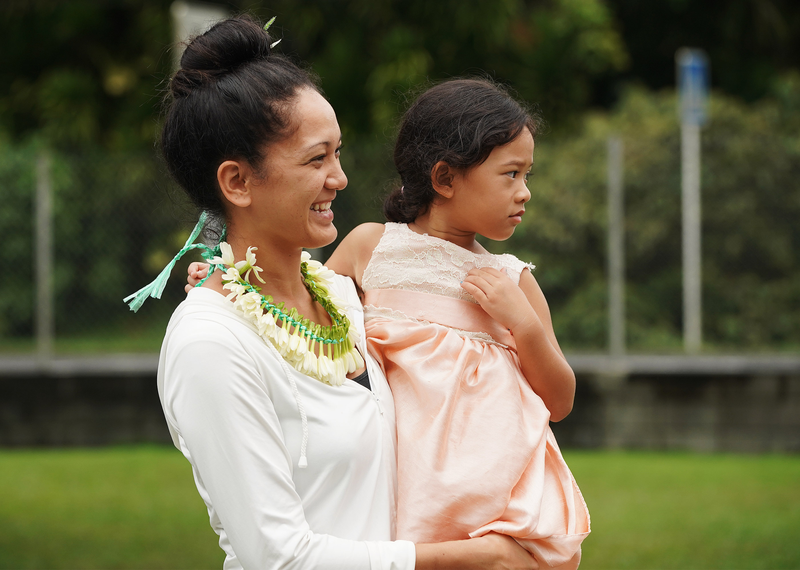 Mau Isabelle Johnston holds her daughter May Kohana after meetings at The Church of Jesus Christ of Latter-day Saints in Papeete, Tahiti, on May 26, 2019.