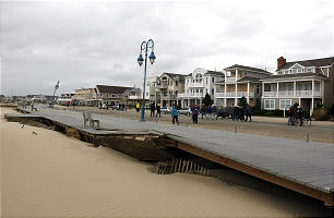 This photo made available by the New Jersey Governor's Office shows damage to the boardwalk in Belmar, N.J. on Tuesday, Oct. 30, 2012 after superstorm Sandy made landfall in New Jersey Monday evening.