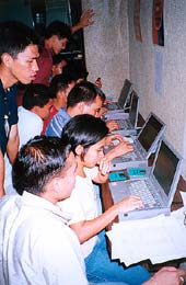Students develop skills and write business plans in computer lab.