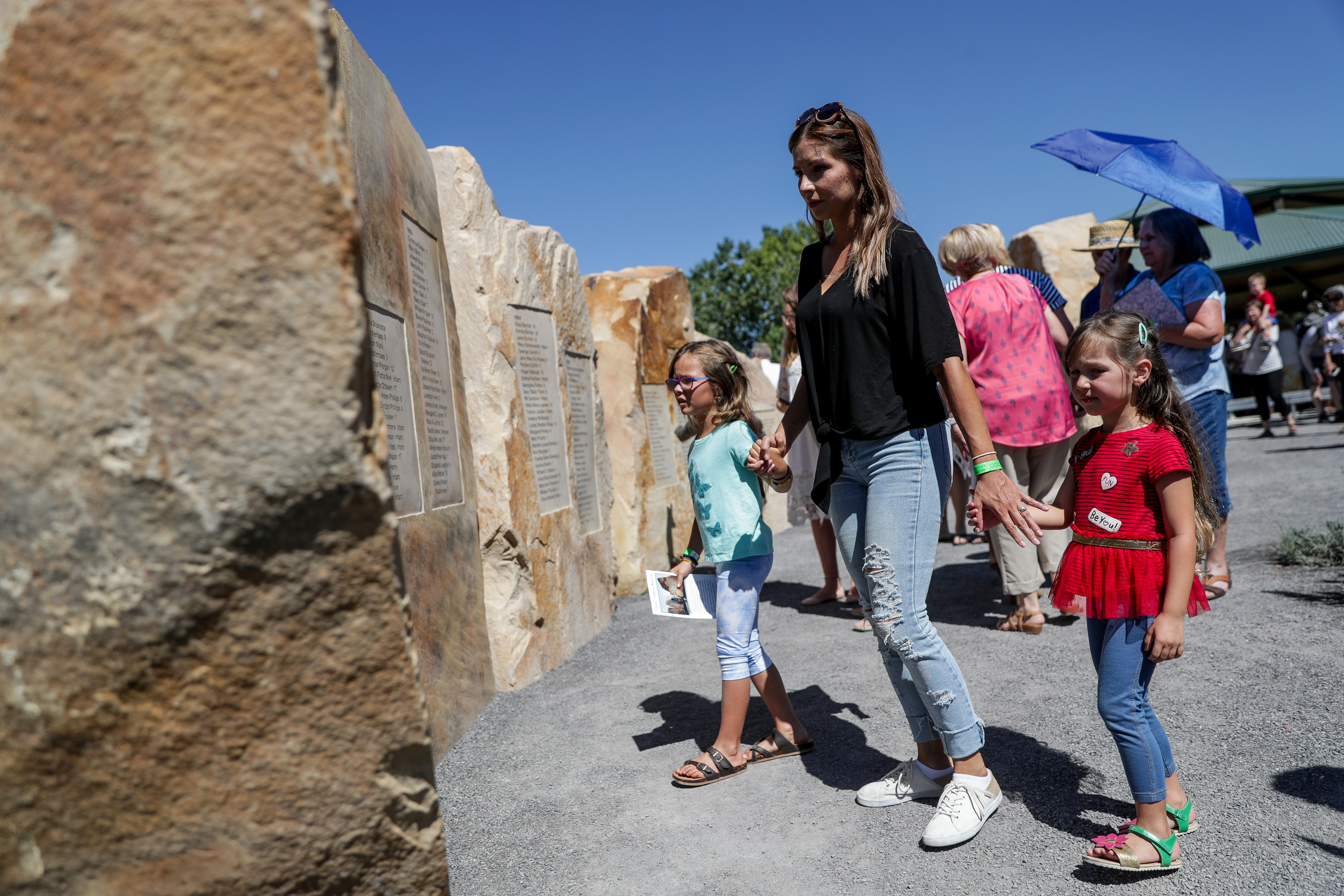 Carolina Murri and her daughters, Fernanda Diaz, 7, and Valentina Diaz, 4, of Herriman, Utah, tour the Children's Pioneer Memorial at This Is the Place Heritage Park after its dedication in Salt Lake City on Saturday, July 20, 2019.
