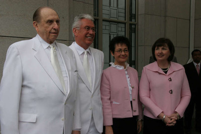 President Thomas S. Monson, President Dieter F. Uchtdorf, first counselor in the First Presidency, Sister Harriet Uchtdorf, and Sister Ann M. Dibb, second counselor in the Young Women general presidency and President Monson's daughter listen to temple cornerstone choir.