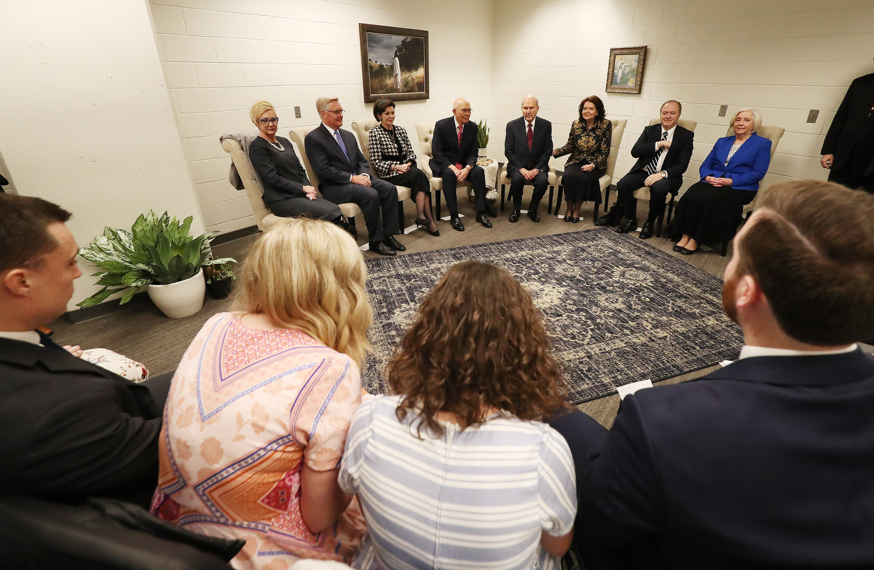 President Russell M. Nelson of The Church of Jesus Christ of Latter-day Saints and President Dallin H. Oaks, first counselor in the First Presidency, talk with 10 young single adults from the area prior to a devotional at the State Farm Stadium in Phoenix on Sunday, Feb. 10, 2019.