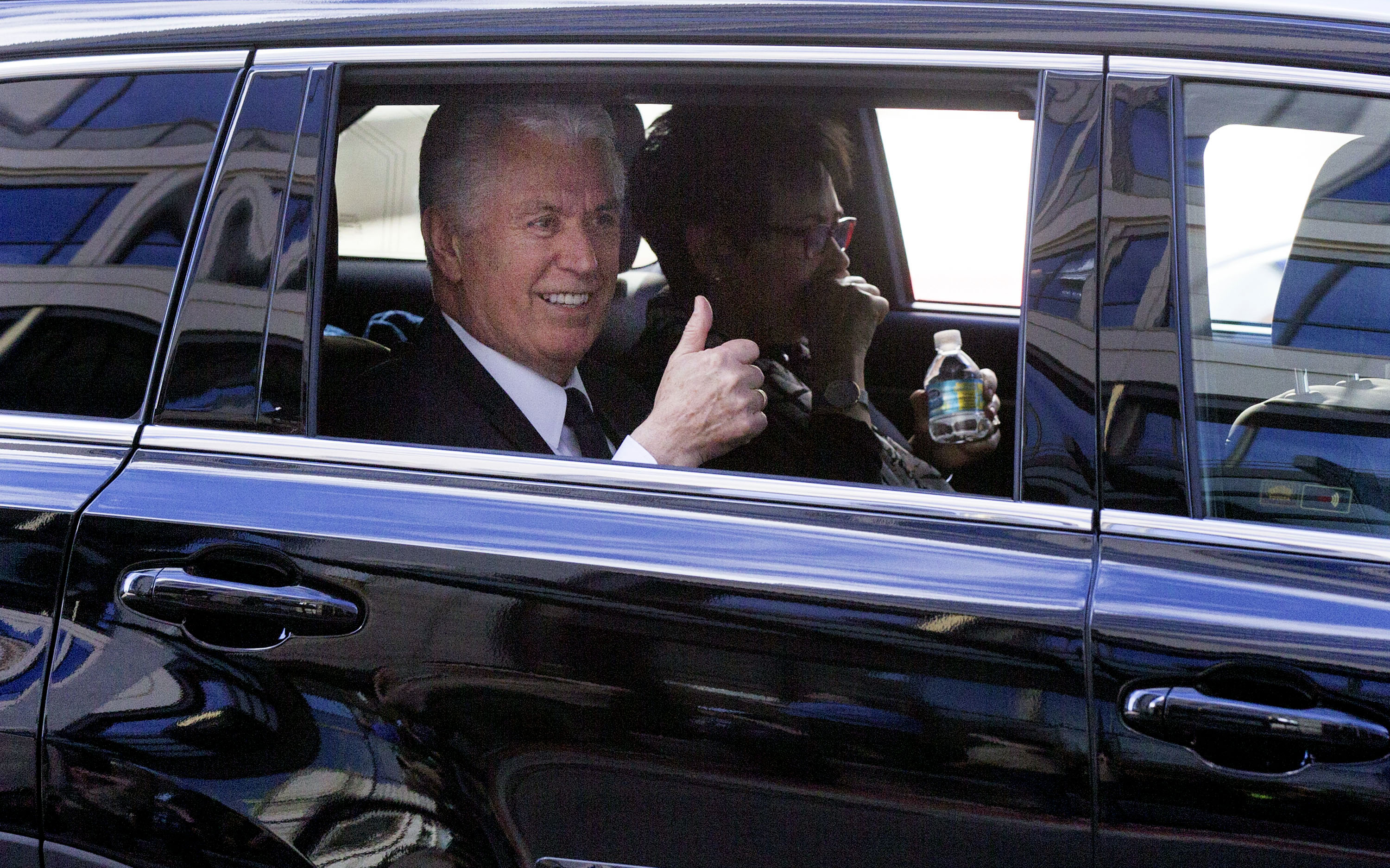 President Dieter F. Uchtdorf gives a thumbs-up sign to Boy Scouts as the funeral procession for LDS Church President Thomas S. Monson makes its way to the Salt Lake City Cemetery on Friday, Jan. 12, 2018. President Uchtdorf was a counselor to President Monson.