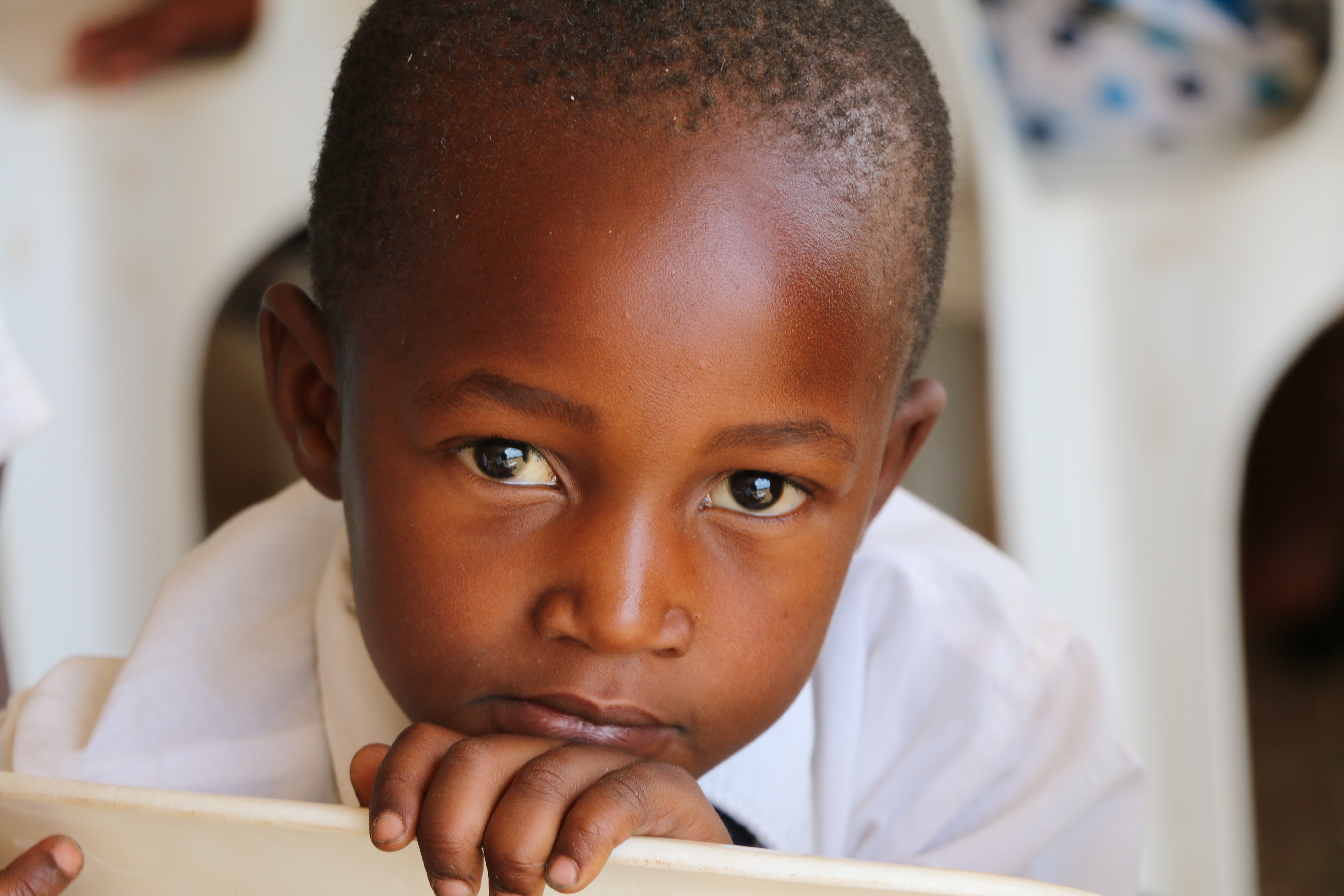 A young boy participates in a member meeting in Zimbabwe on Nov. 18. 2018.