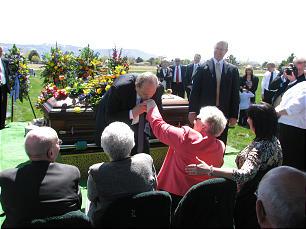 Funeral of Elder Jack H. Goaslind Jr. on May 2, 2011.Tuesday, May3, 2011. At graveside, after placing a rose on the casket, President Thomas S. Monson kisses the hand of Sister Gwen Caroline Bradford Goaslind, widow of Elder Goaslind.