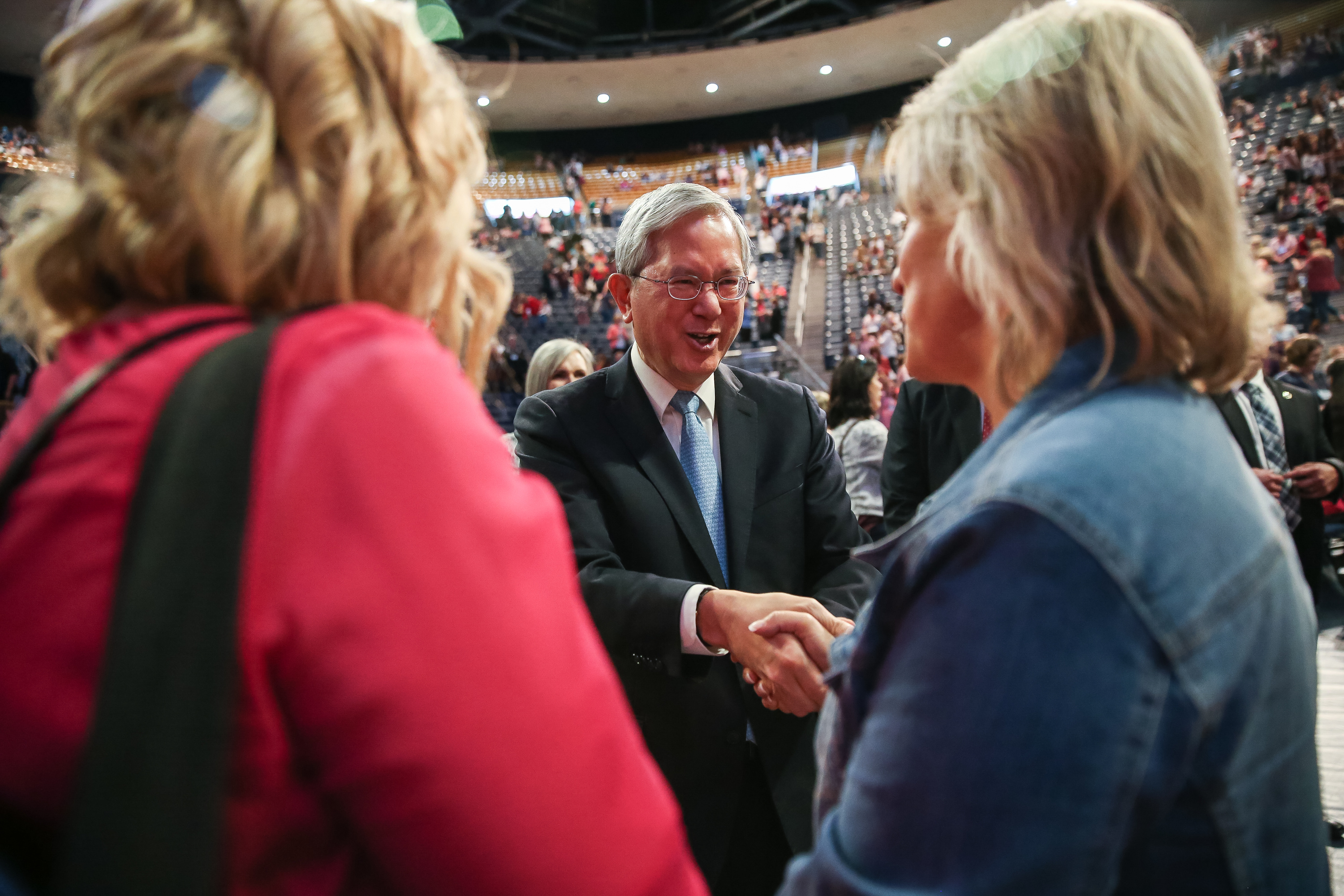 Elder Gerrit W. Gong, of the Quorum of the Twelve Apostles of the LDS Church, greets attendees after speaking at the BYU Women's Conference at the Marriott Center in Provo on Friday, May 4, 2018.