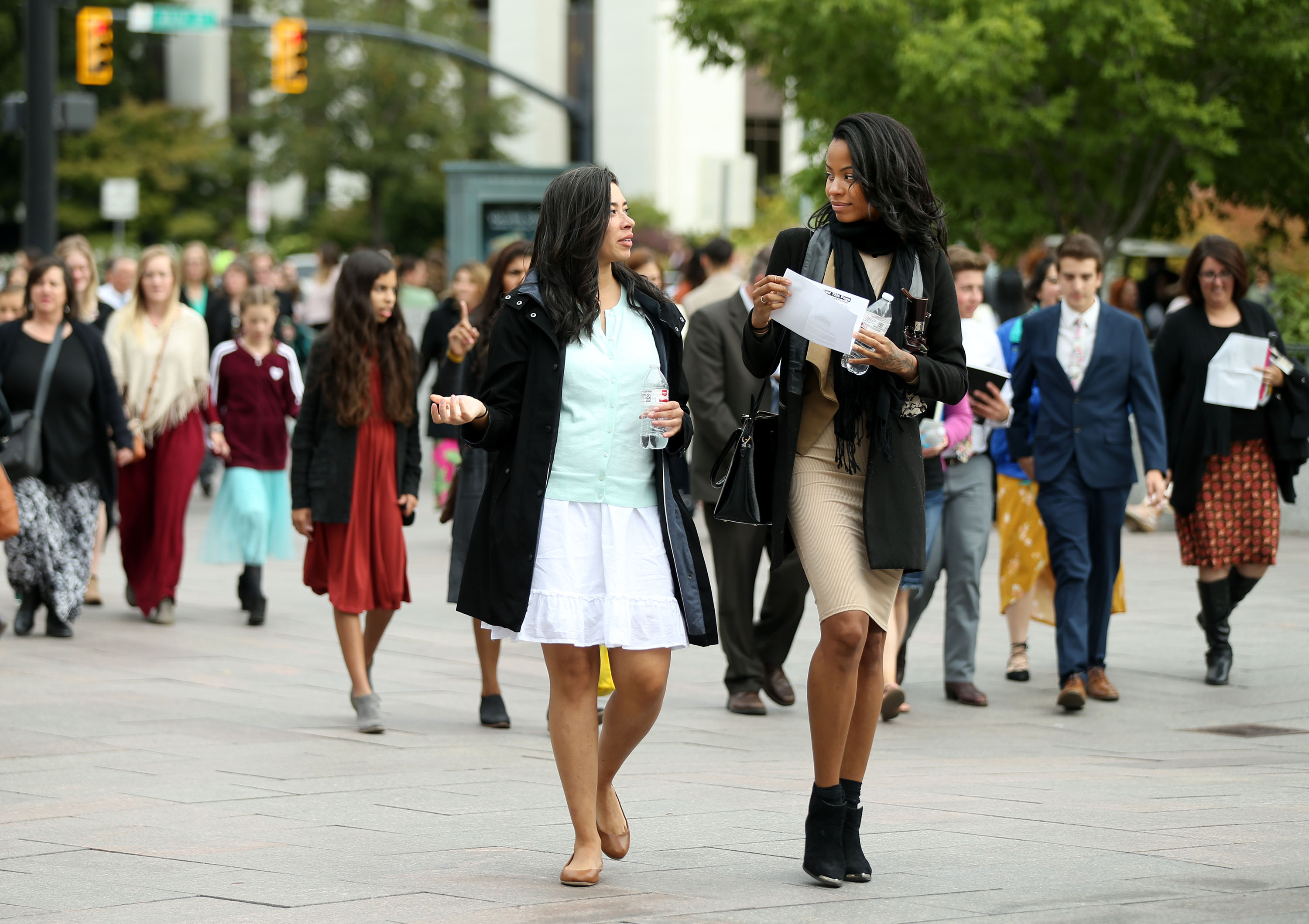 Women head to the general women's session of the 188th Semiannual General Conference of The Church of Jesus Christ of Latter-day Saints held in the Conference Center in downtown Salt Lake City on Saturday, Oct. 6, 2018.