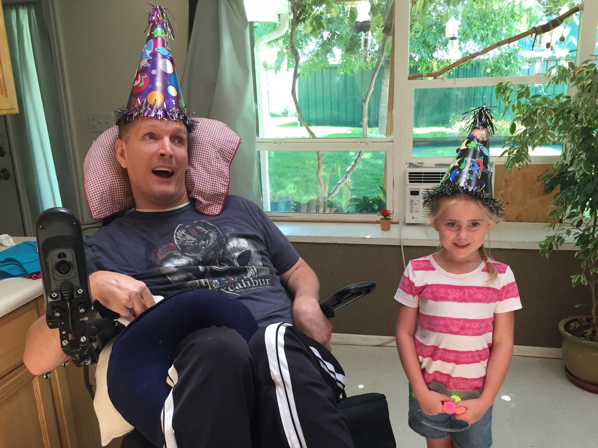Orin Vooheis with his friend, Addie McClure, the daughter of one his aides. More than 20 years after being shot in the head on his mission, Voorheis is living a happy life surrounded by family and friends.