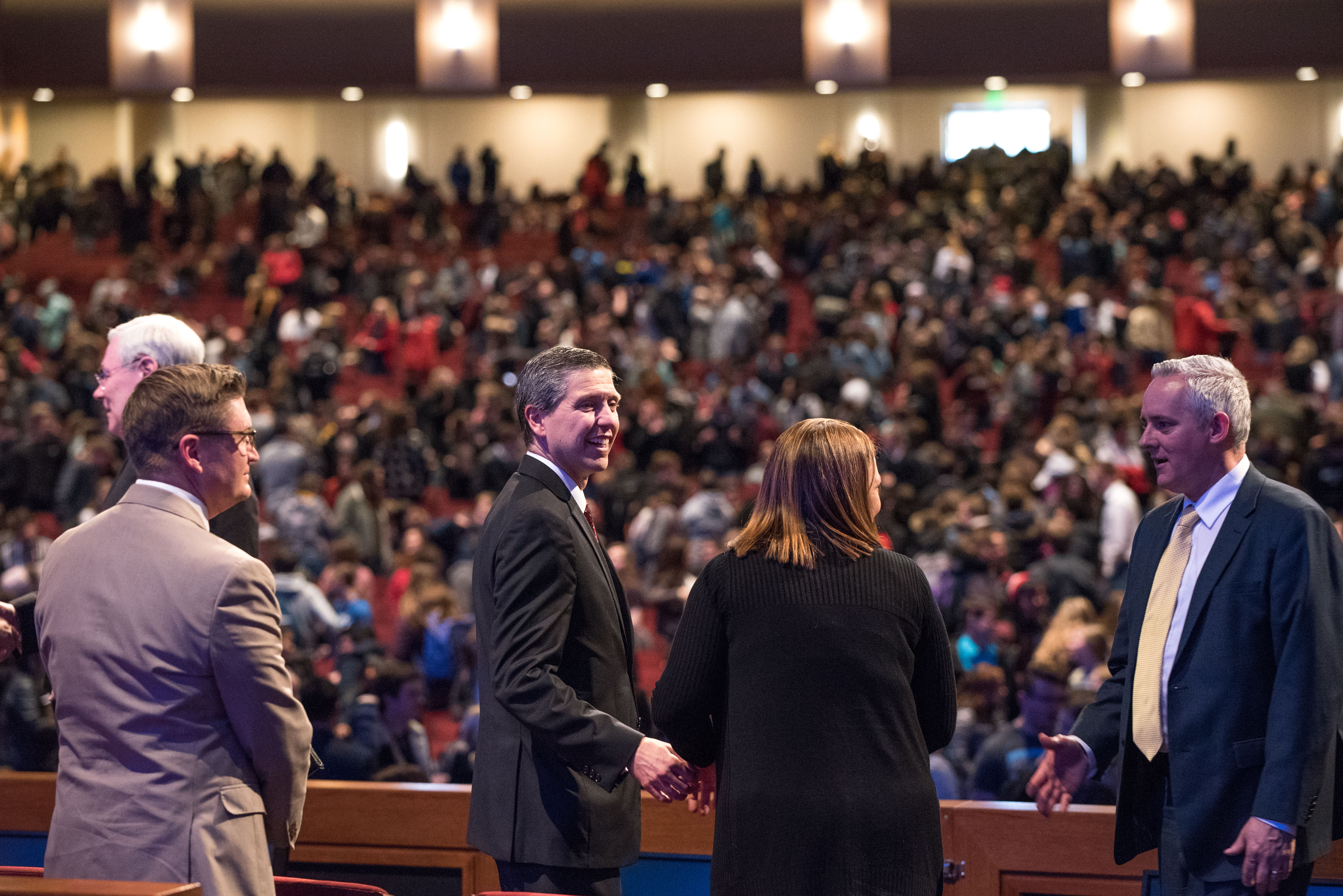 Elder Joaquin E. Costa, a General Authority Seventy, and his wife, Sister Renee Costa (center), following their devotional at BYU–Idaho on Feb. 26.