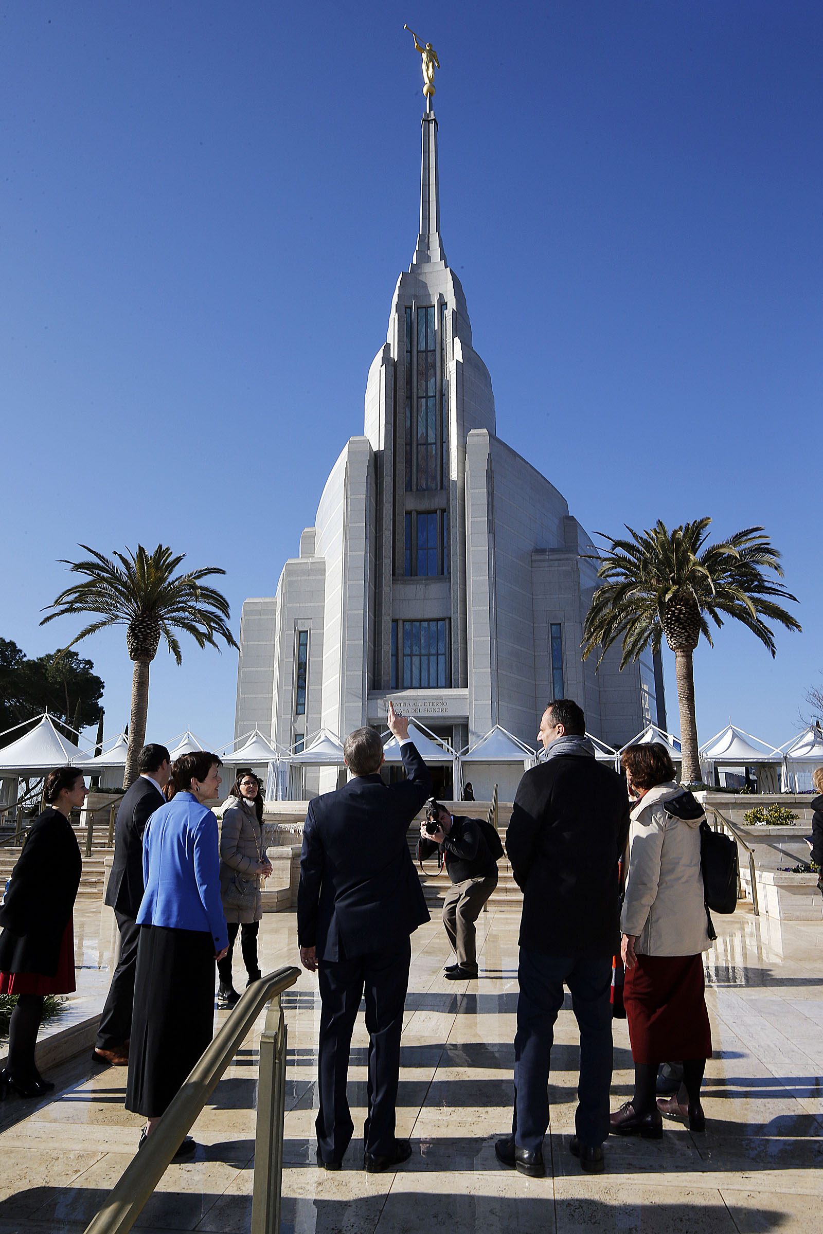 Elder David A. Bednar of the Quorum of the Twelve Apostles of The Church of Jesus Christ of Latter-day Saints points out features of the Rome Italy Temple on Monday, Jan. 14, 2019. At right is President Marcello De Vito of the Rome City Council. At left is Elder Bednar's wife, Sister Susan Bednar.