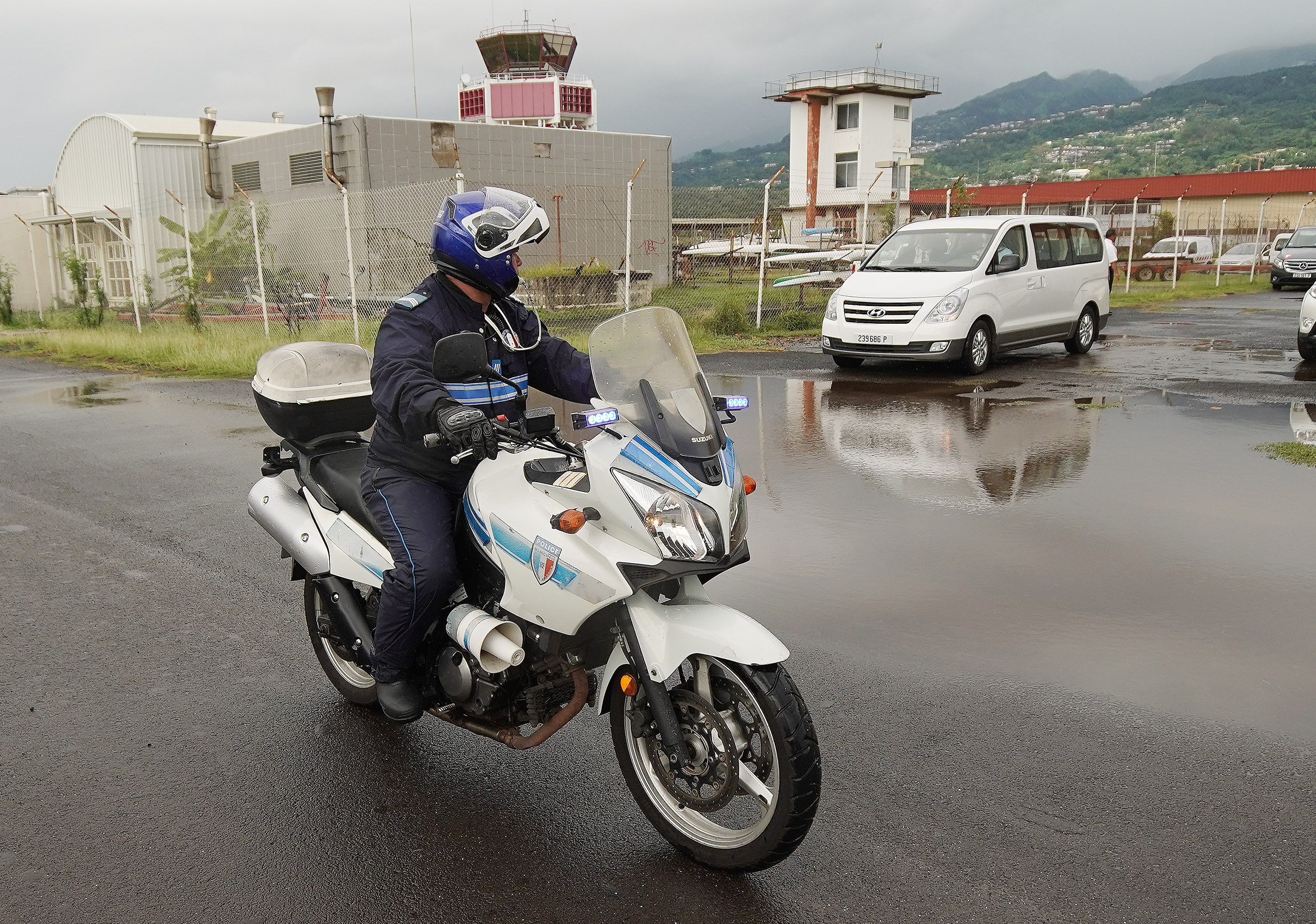 Police escort President Russell M. Nelson of The Church of Jesus Christ of Latter-day Saints upon arrival in Papeete, Tahiti, on May 23, 2019.