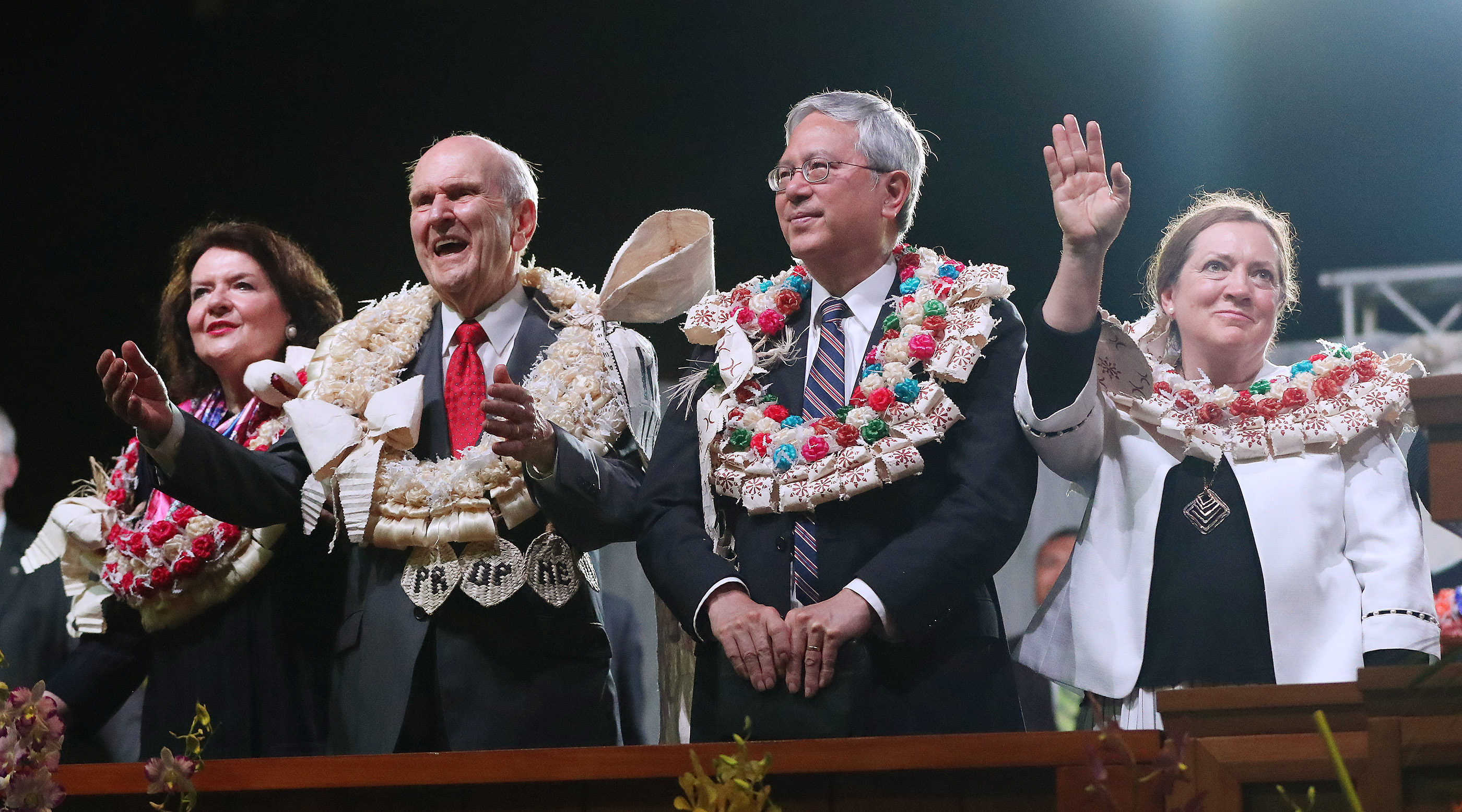 President Russell M. Nelson of The Church of Jesus Christ of Latter-day Saints and his wife, Sister Wendy Nelson, and Elder Elder Gerrit W. Gong of the Quorum of the Twelve Apostles and his wife, Sister Susan Gong, wave goodbye to attendees after a devotional in Nausori, Fiji, on May 22, 2019.