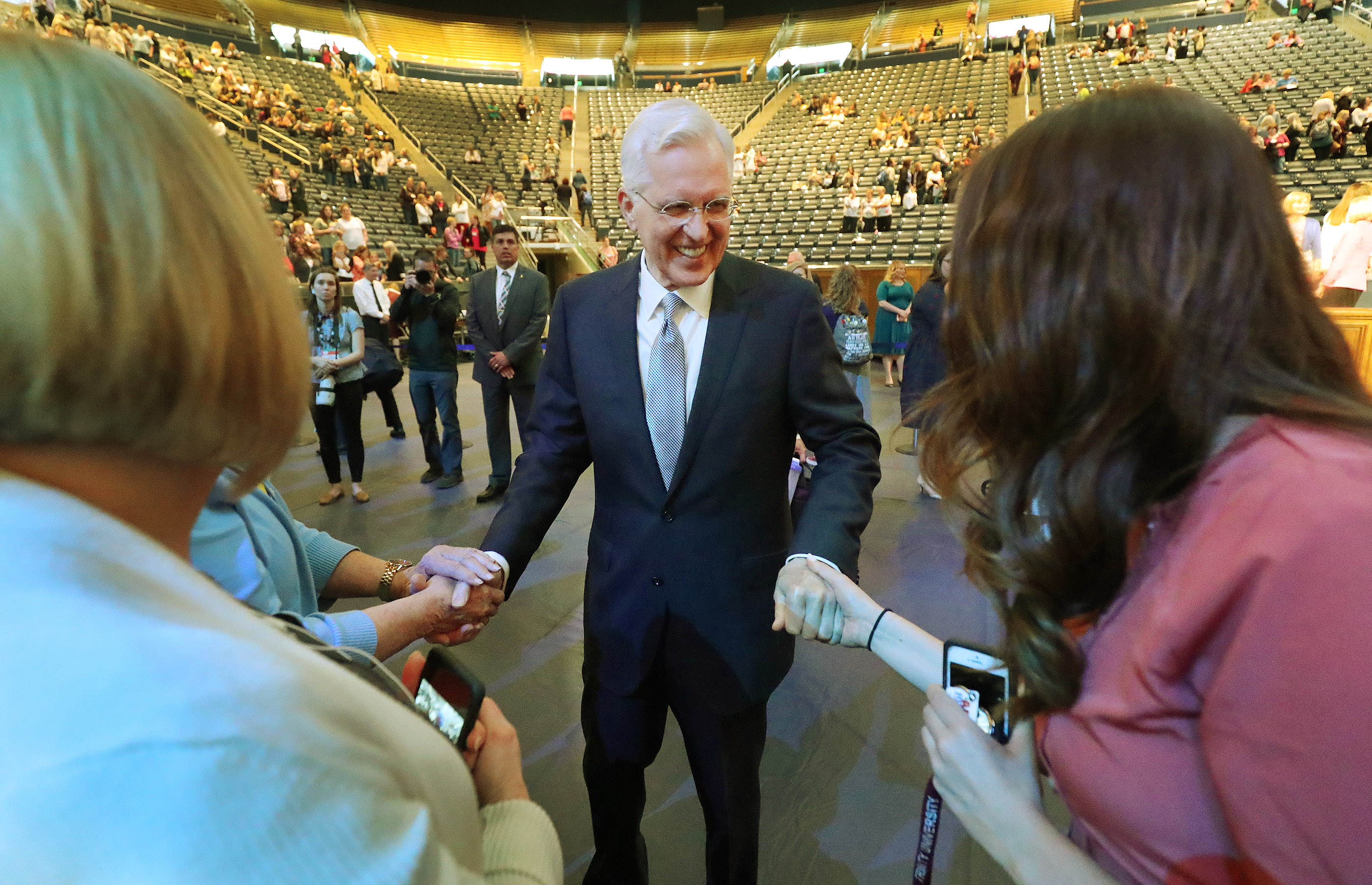 Elder D. Todd Christofferson of the Quorum of the Twelve Apostles for The Church of Jesus Christ of Latter-day Saints shakes hands with attendees after speaking at BYU Women's Conference in Provo on Friday, May 3, 2019.