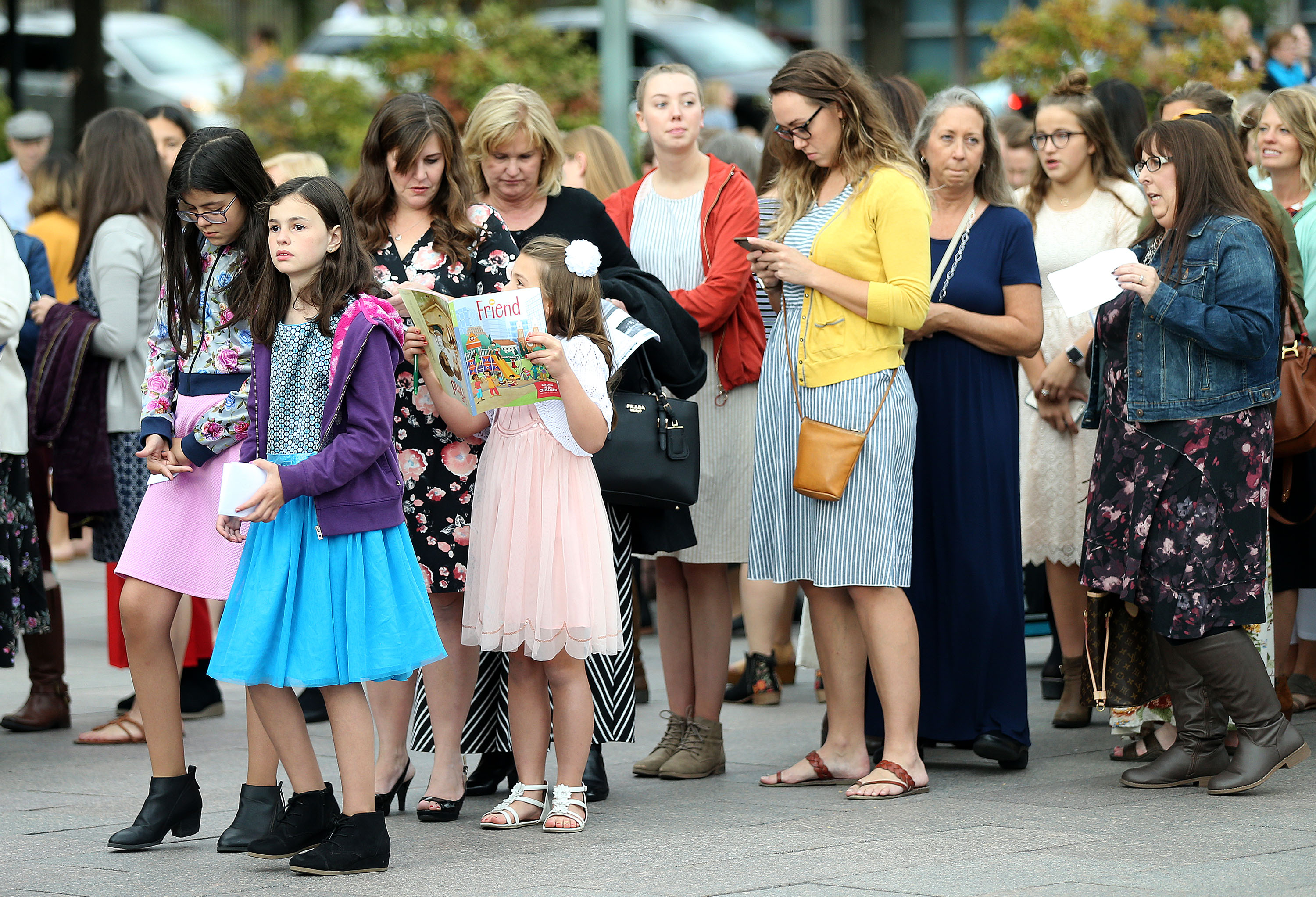 Women and children line up to enter the general women's session of the 188th Semiannual General Conference of The Church of Jesus Christ of Latter-day Saints held in the Conference Center in downtown Salt Lake City on Saturday, Oct. 6, 2018.